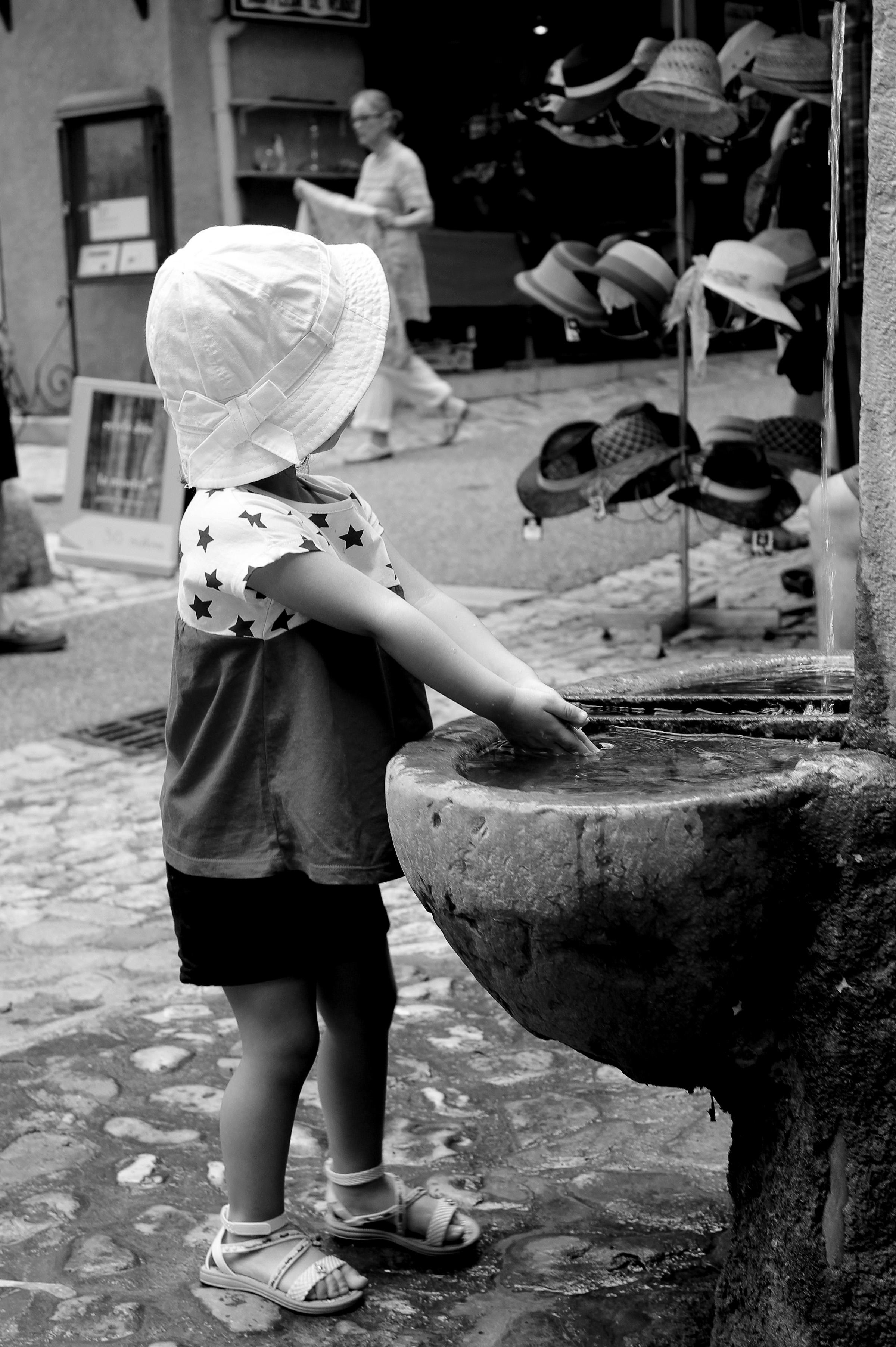 Toddler washing her hands photo