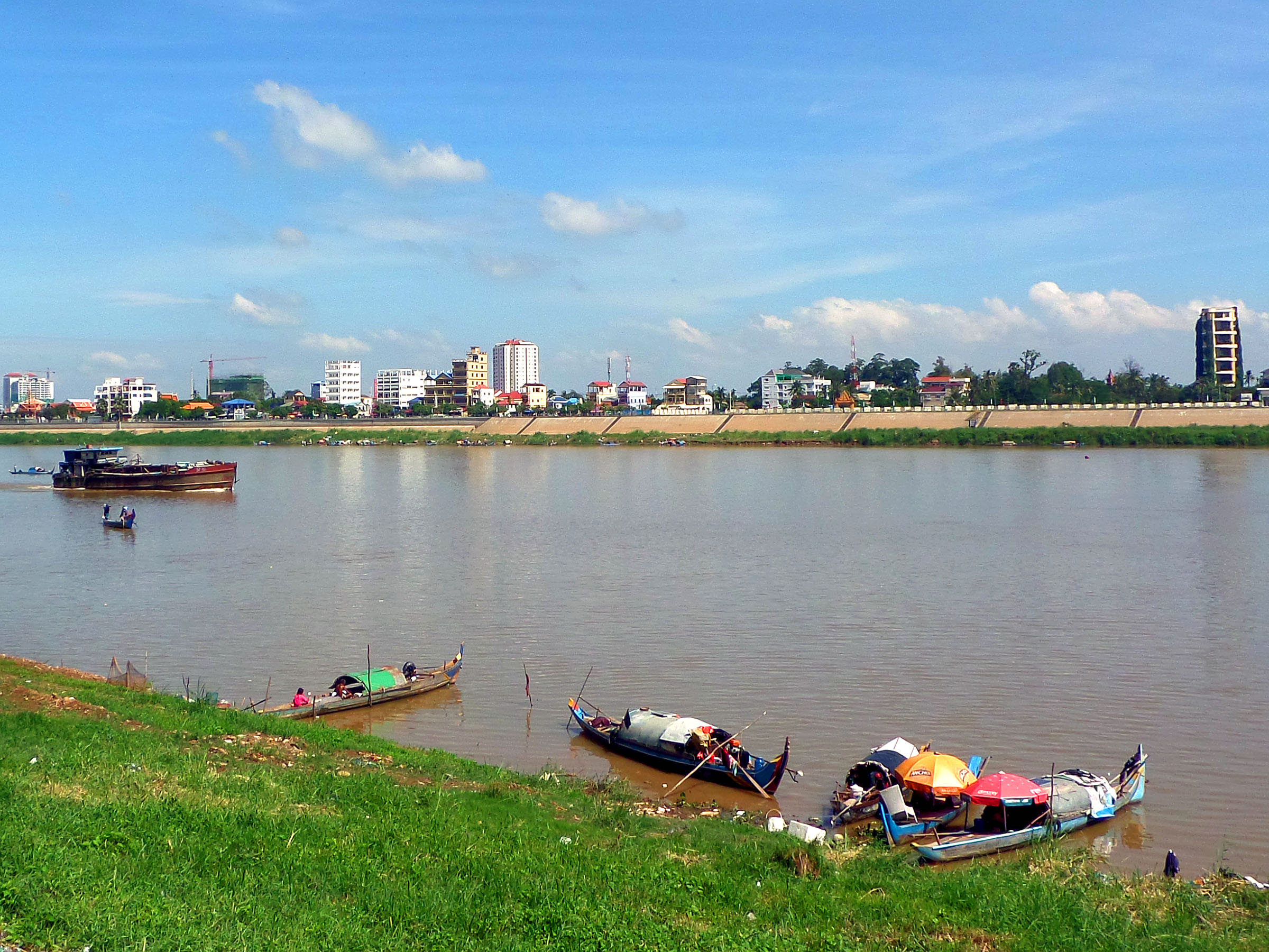 Tonle sap river and boats photo