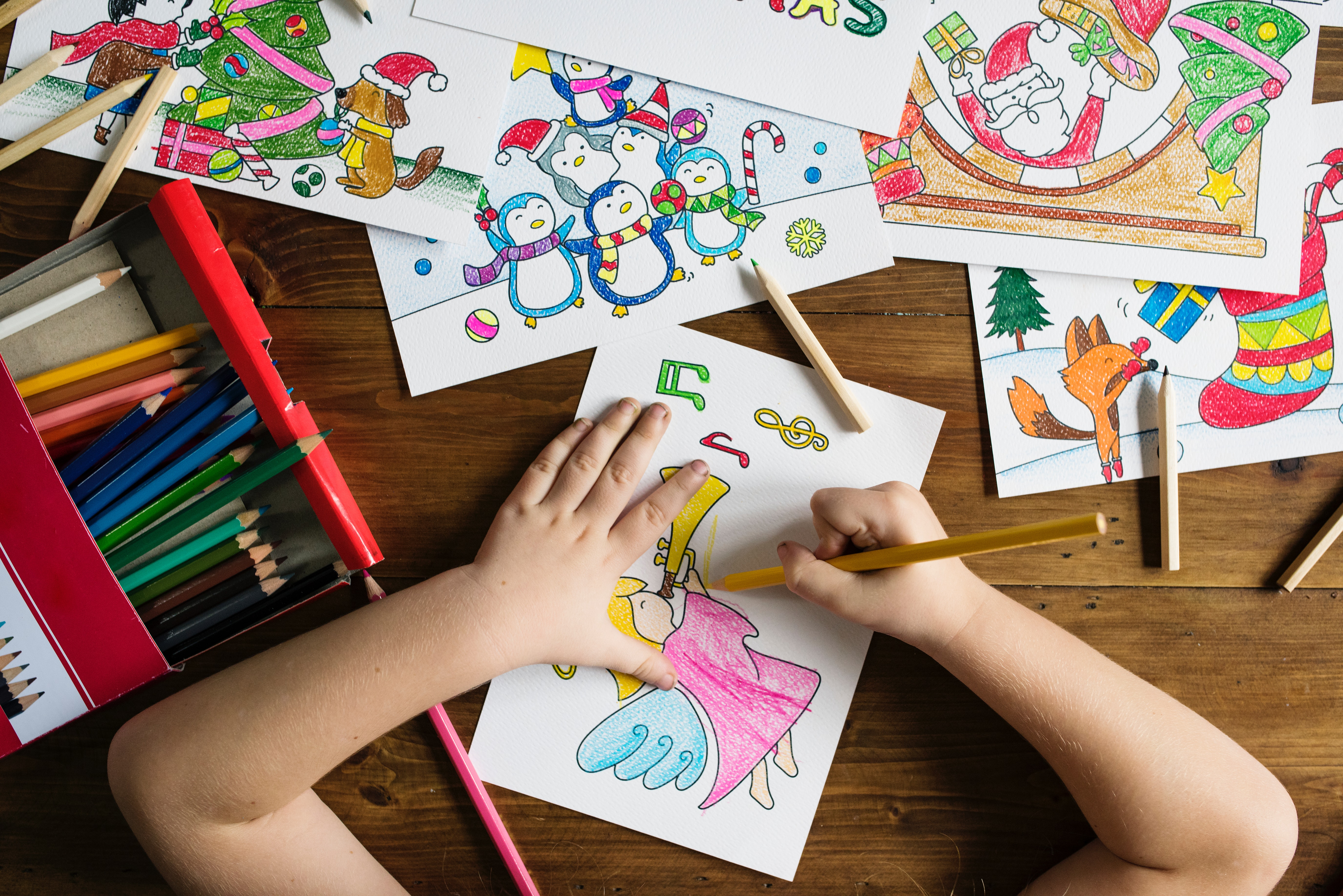 Top Angle Photo of Child Holding Pencil While Drawing Female Angel Playing Wind Instrument, Paper, Pencils, Kid, Indoors, HQ Photo