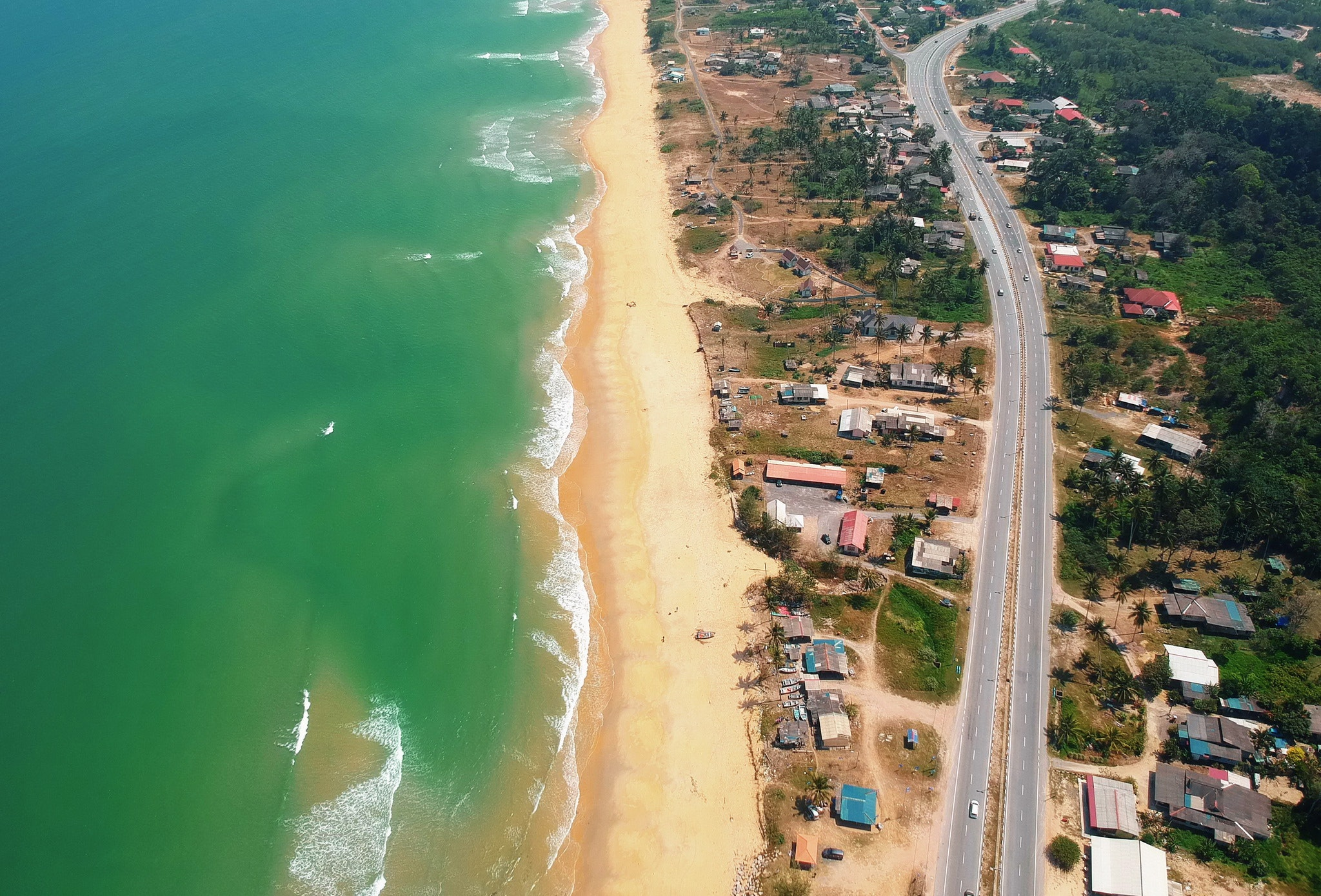 Top view of blue sea and brown sand photo