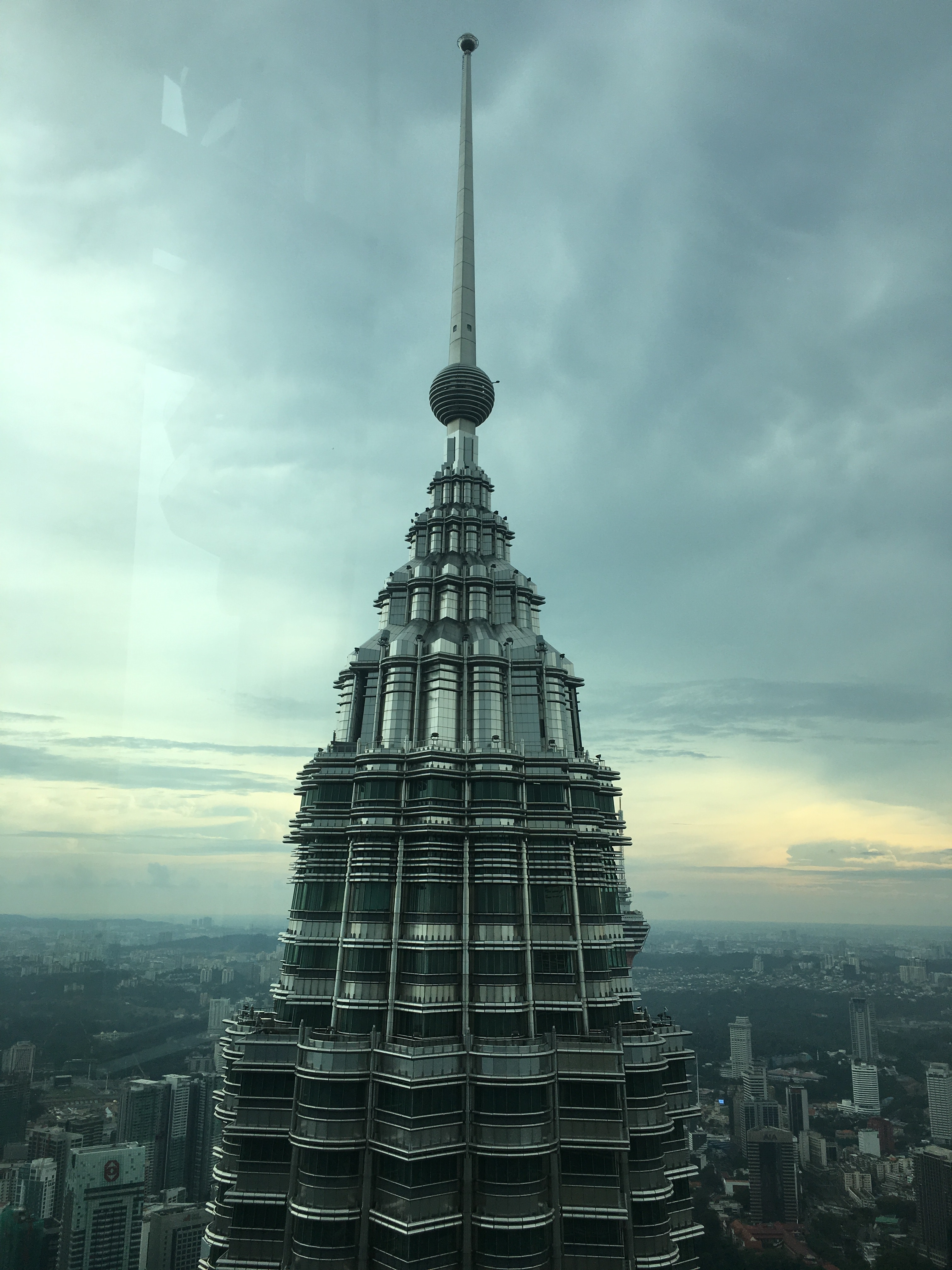 Tower building landmark under cloudy sky photo