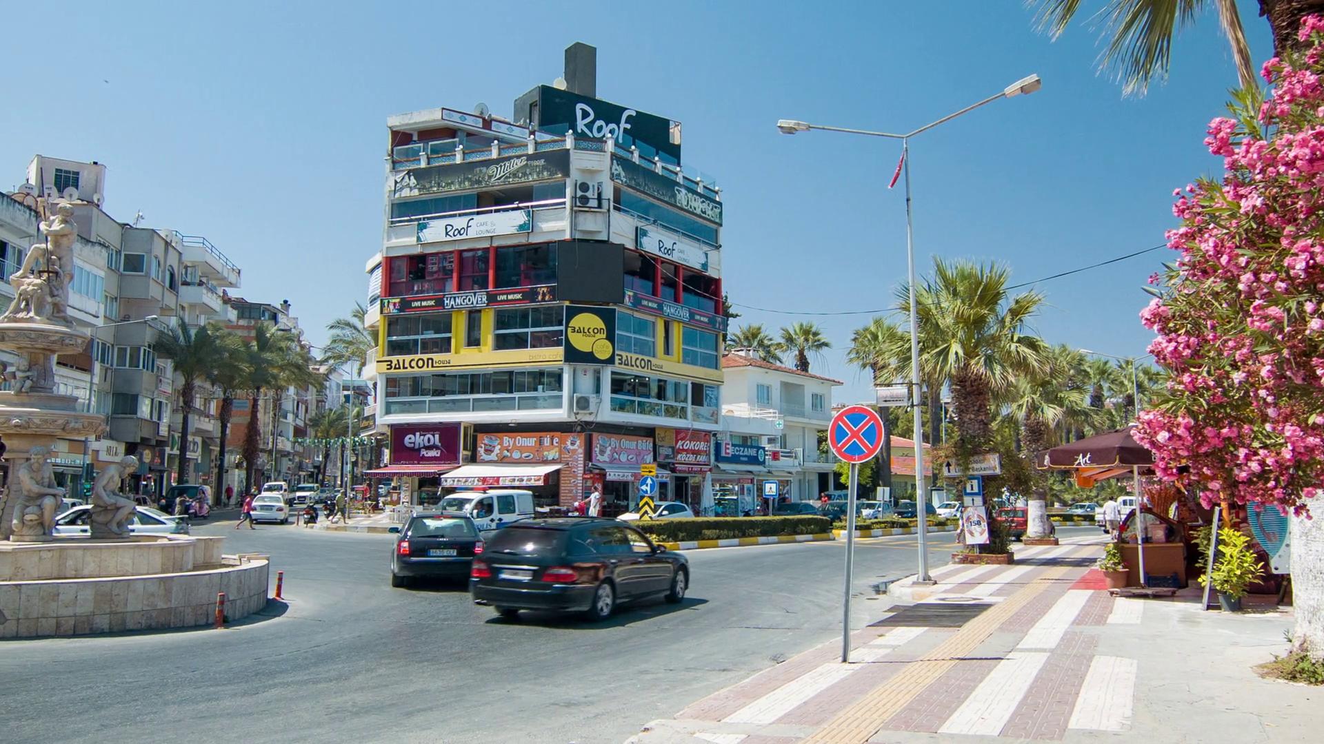 Kusadasi Turkey Town Center Street Traffic Scene with Cars Driving ...