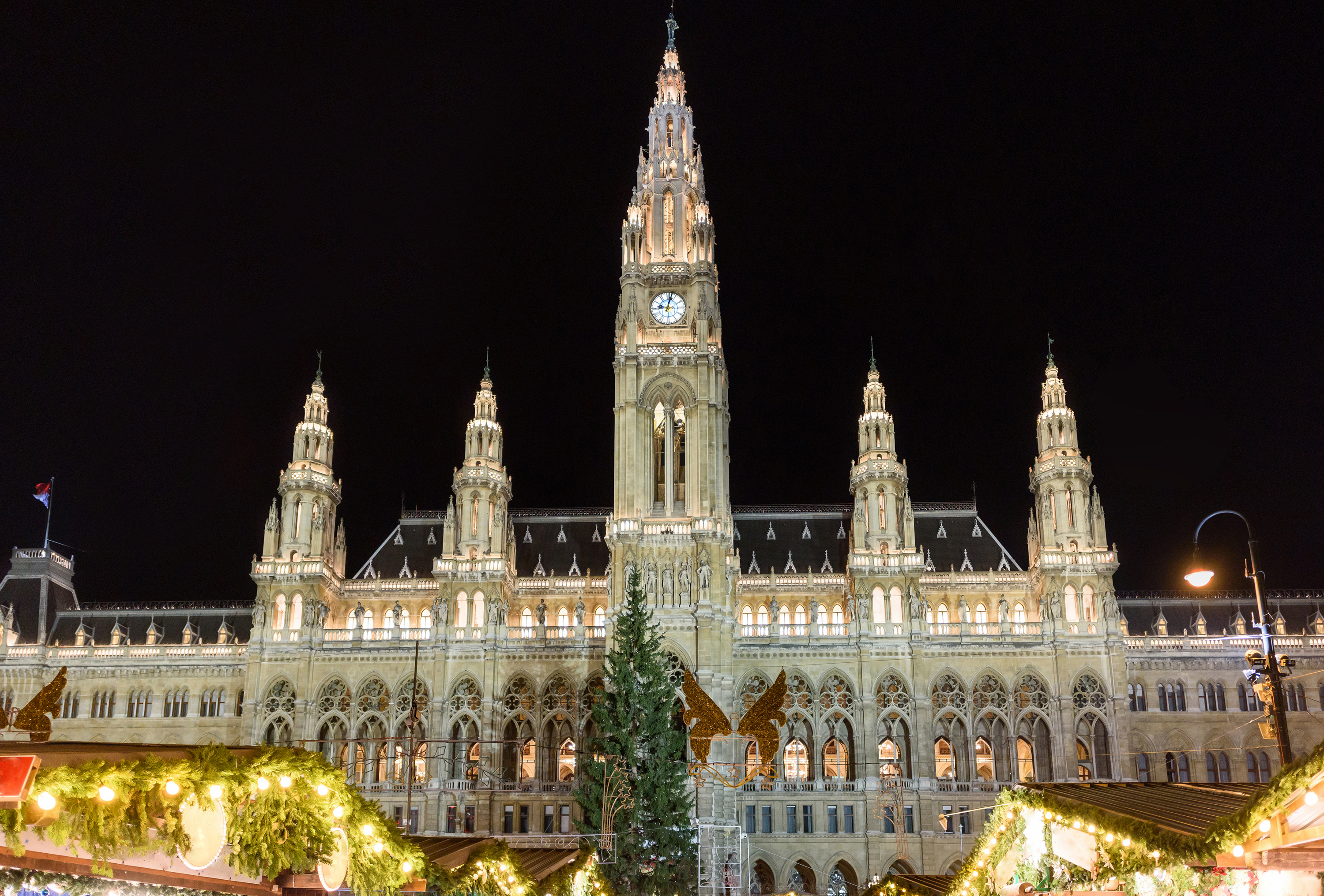 Traditional christmas market at rathaus in vienna at night photo