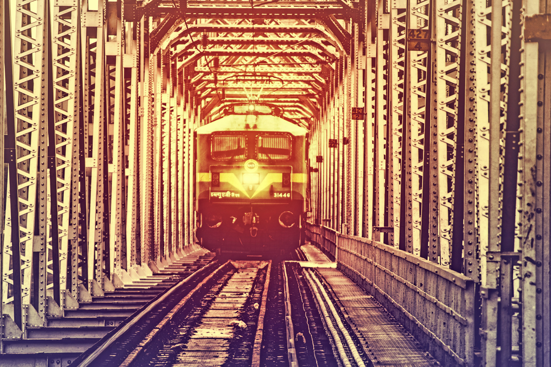 Train crossing metal bridge photo