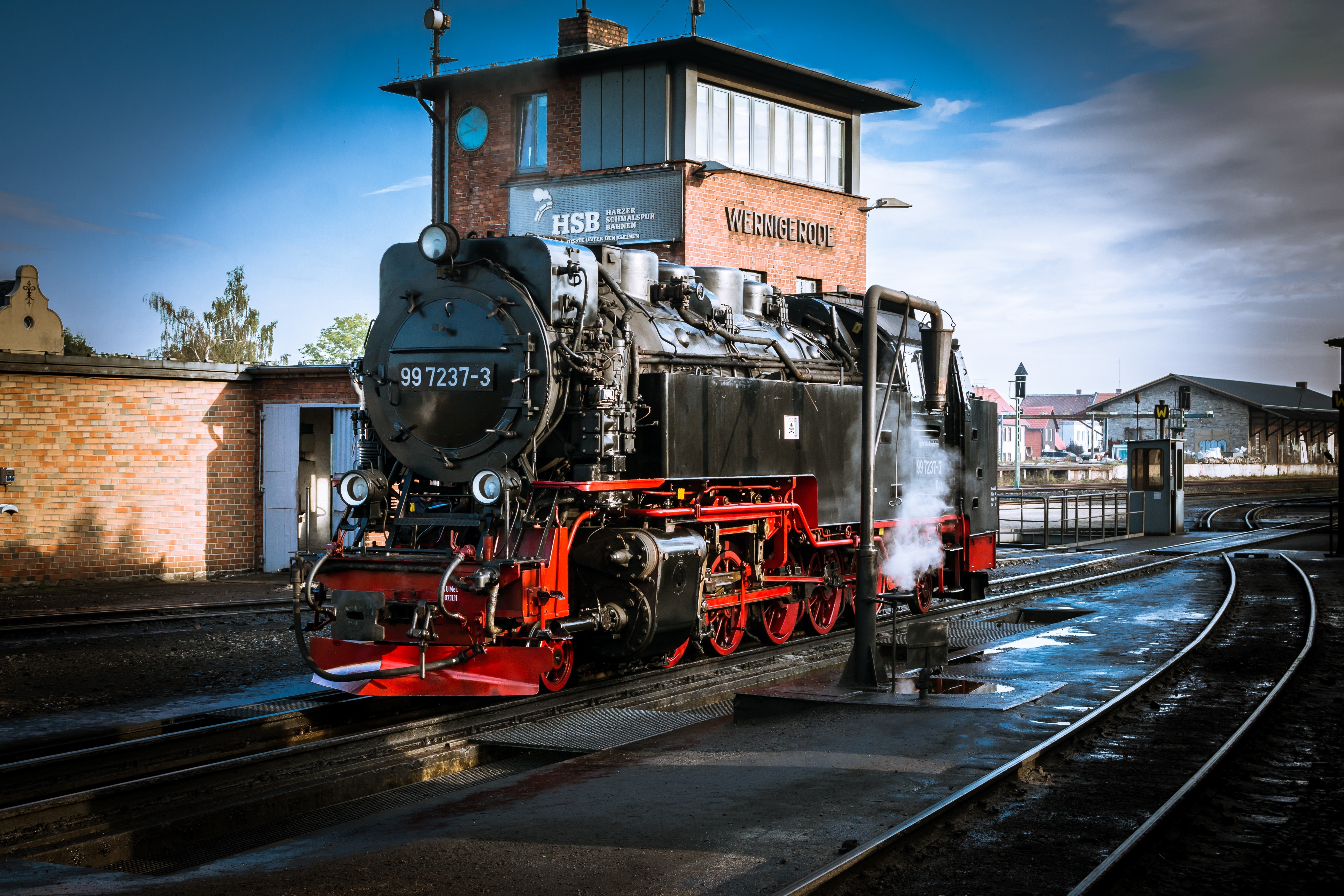 Train on railroad tracks against sky photo