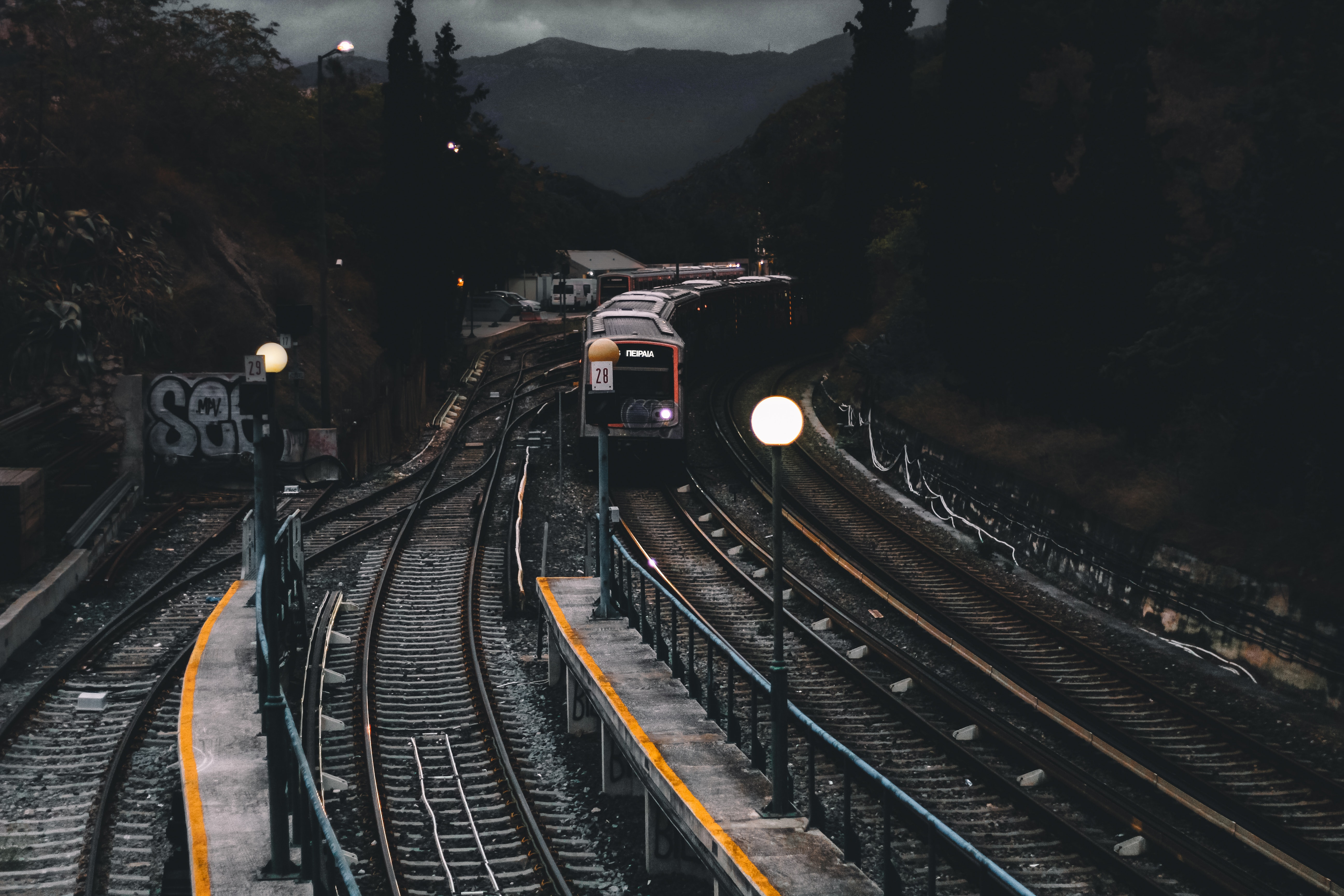 Train on railways during nighttime photo