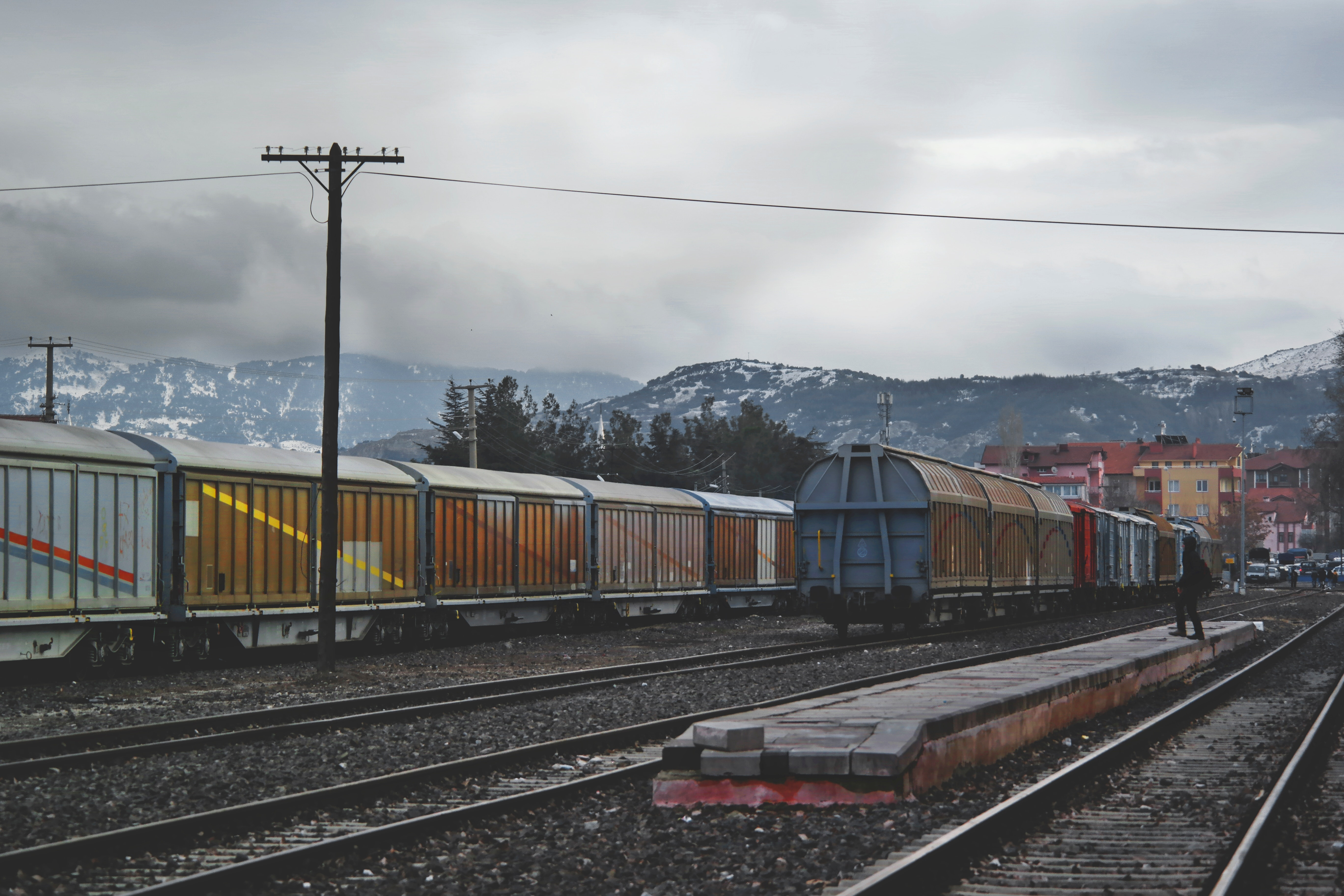 Train running on train track under gray sky at daytime photo