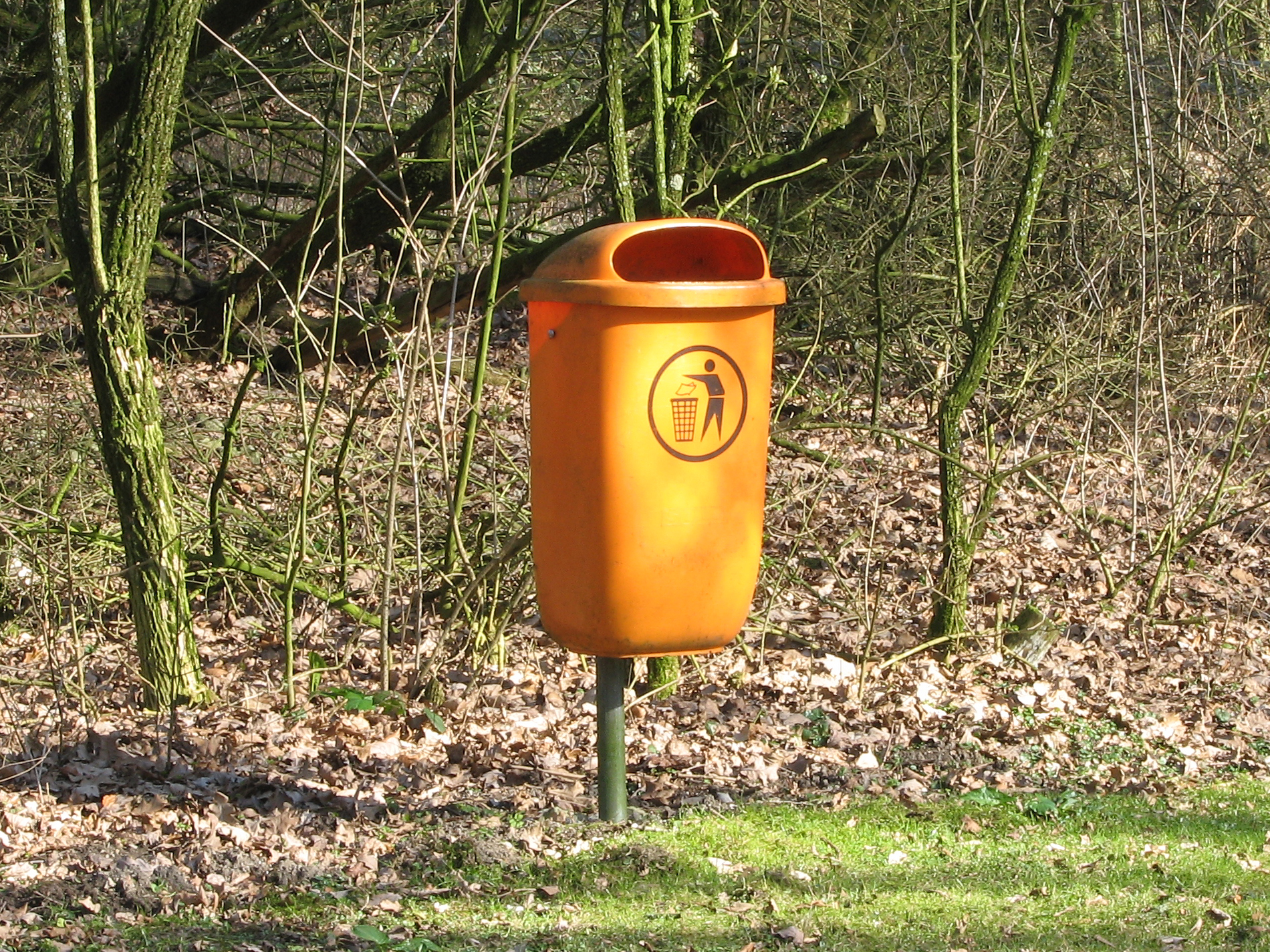 Trashcan in park photo