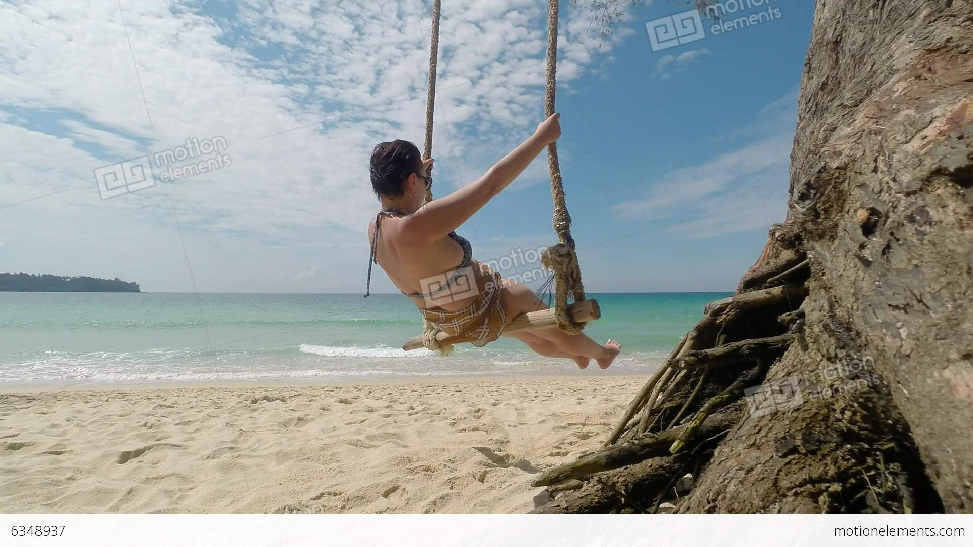 Woman On Swing On Tropical Beach Stock video footage | 6348937
