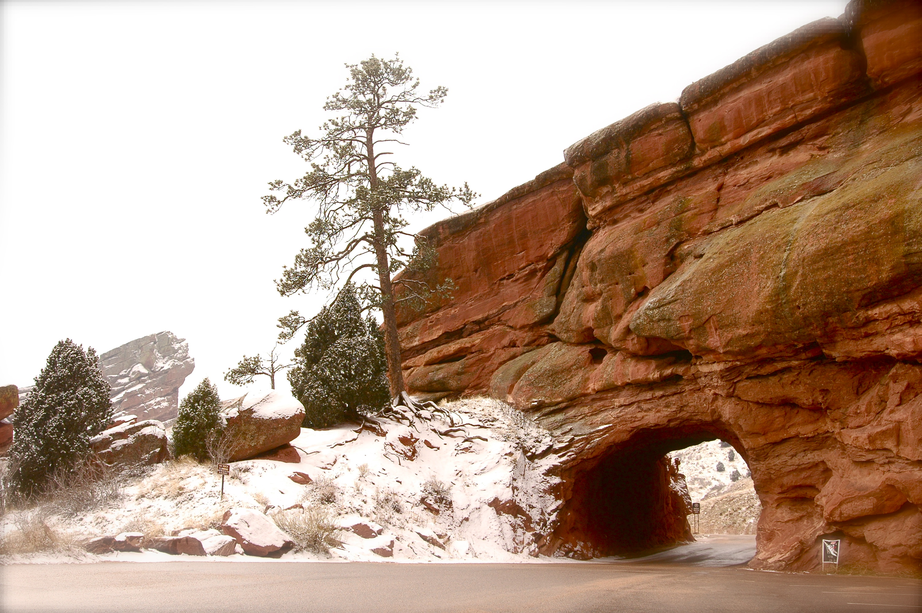Tunnel through the snowy red rocks photo
