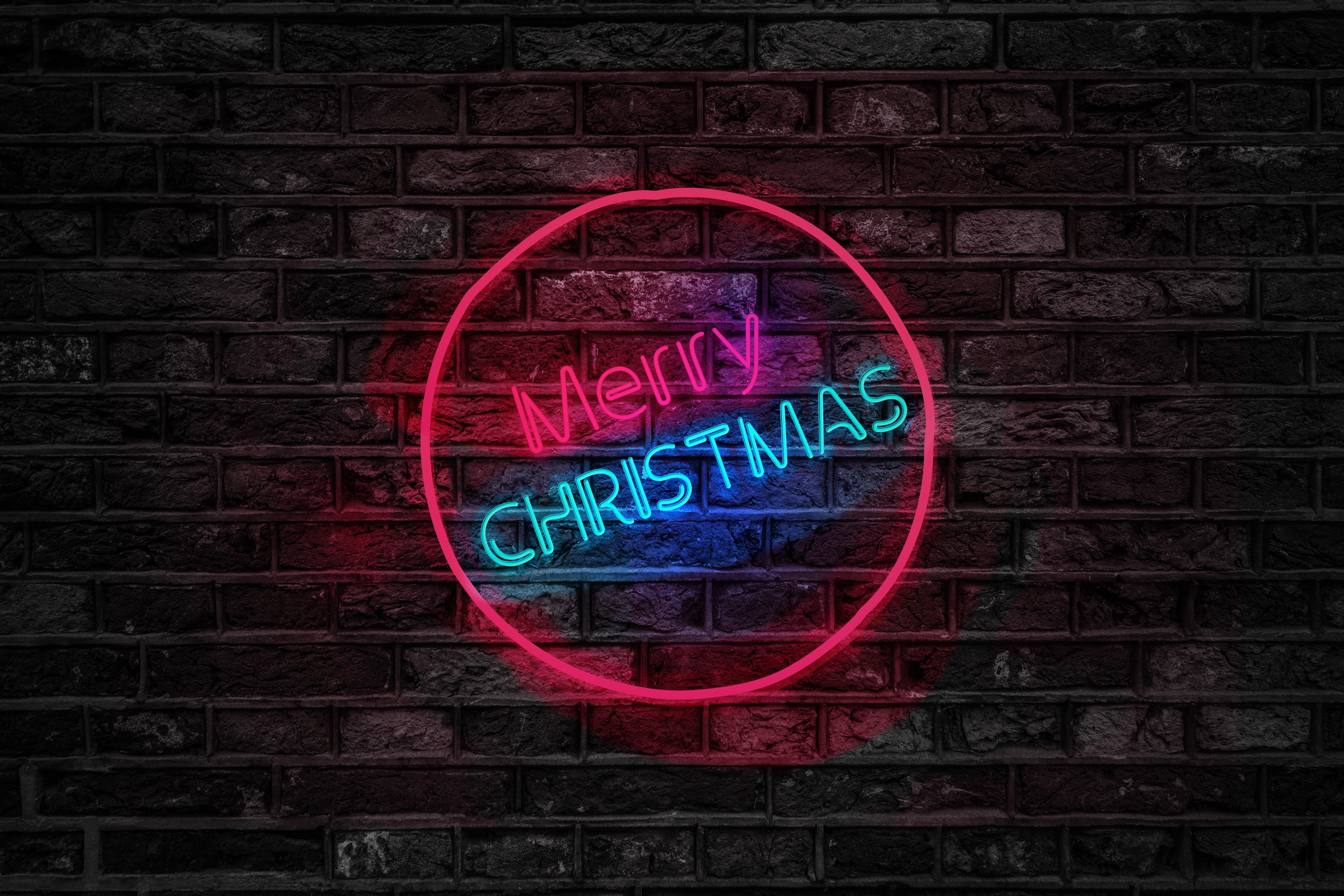 turned on red and blue merry christmas neon sign neon lights night time