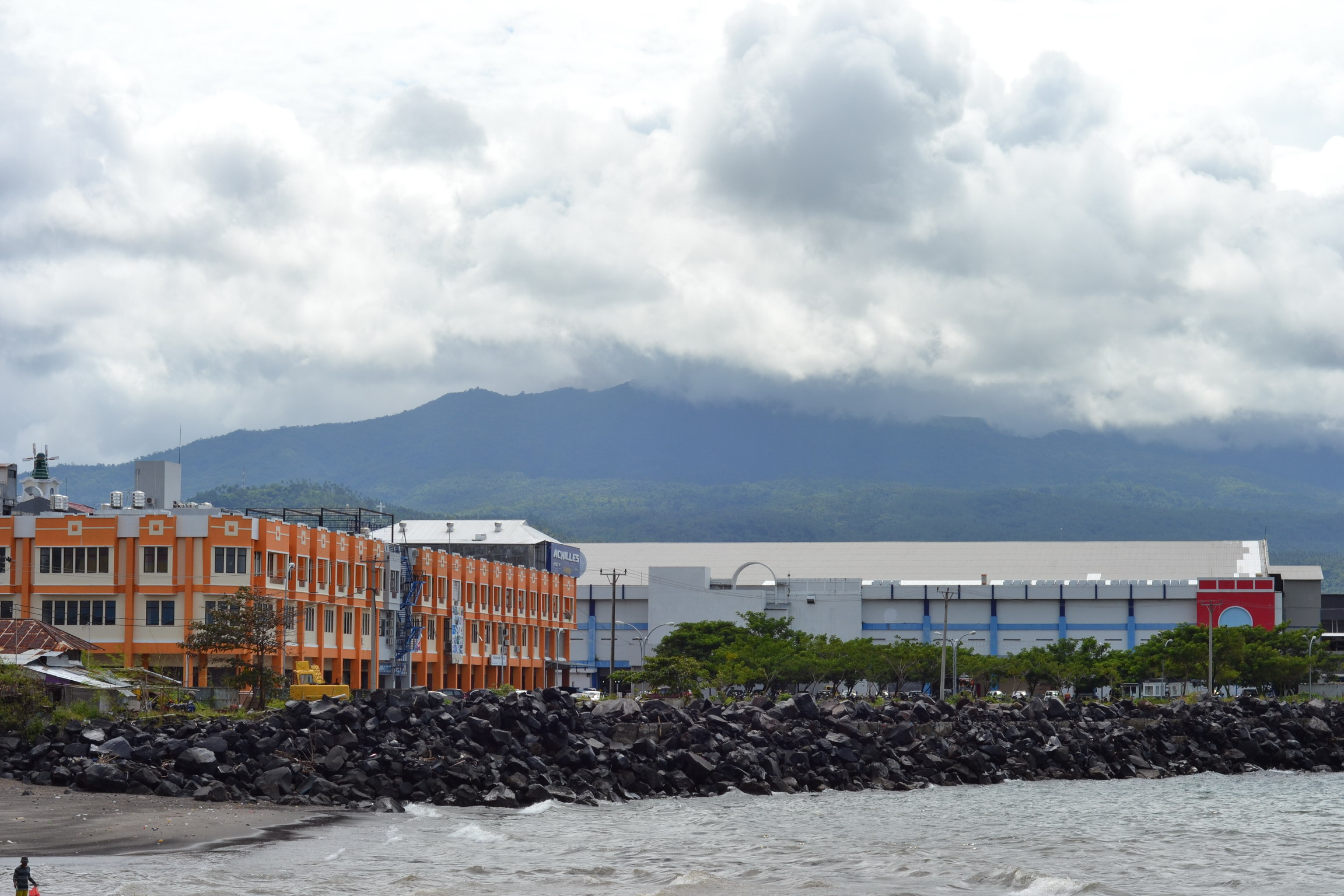 Two buildings near ocean photo