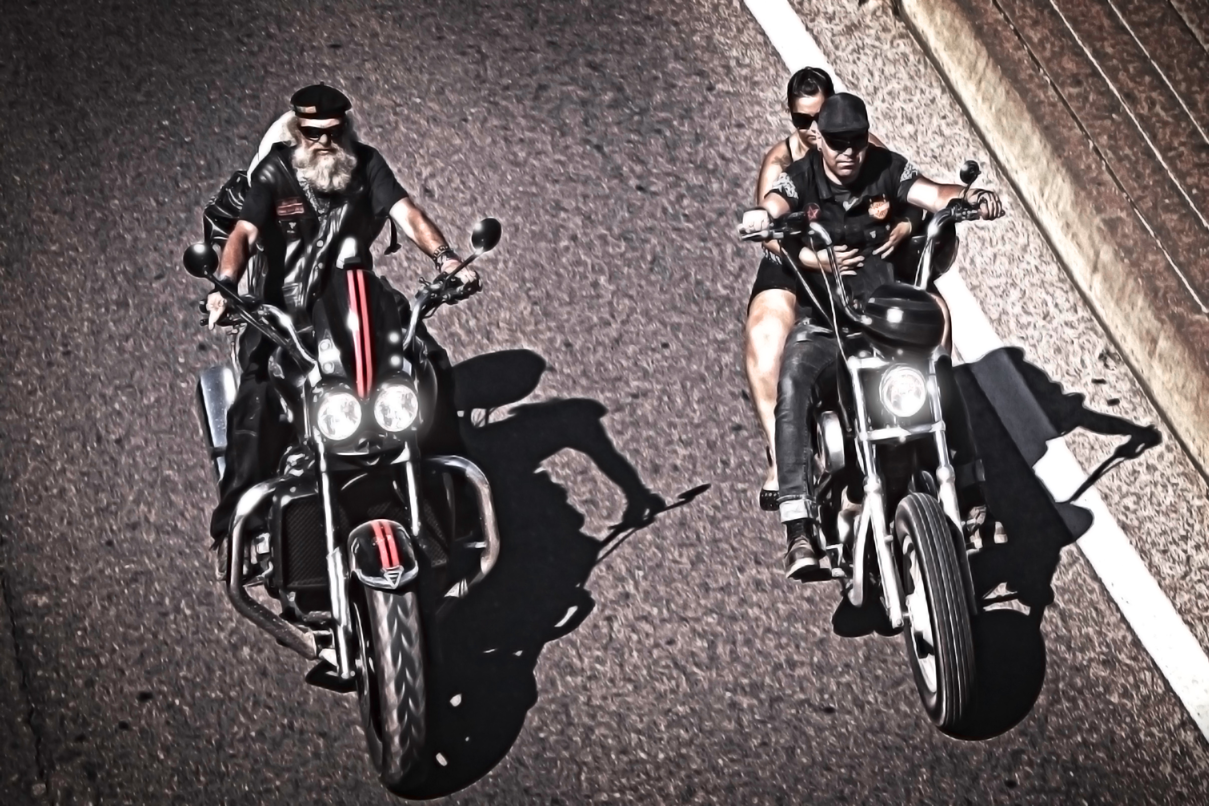 Two generations of bikers riding chopper photo