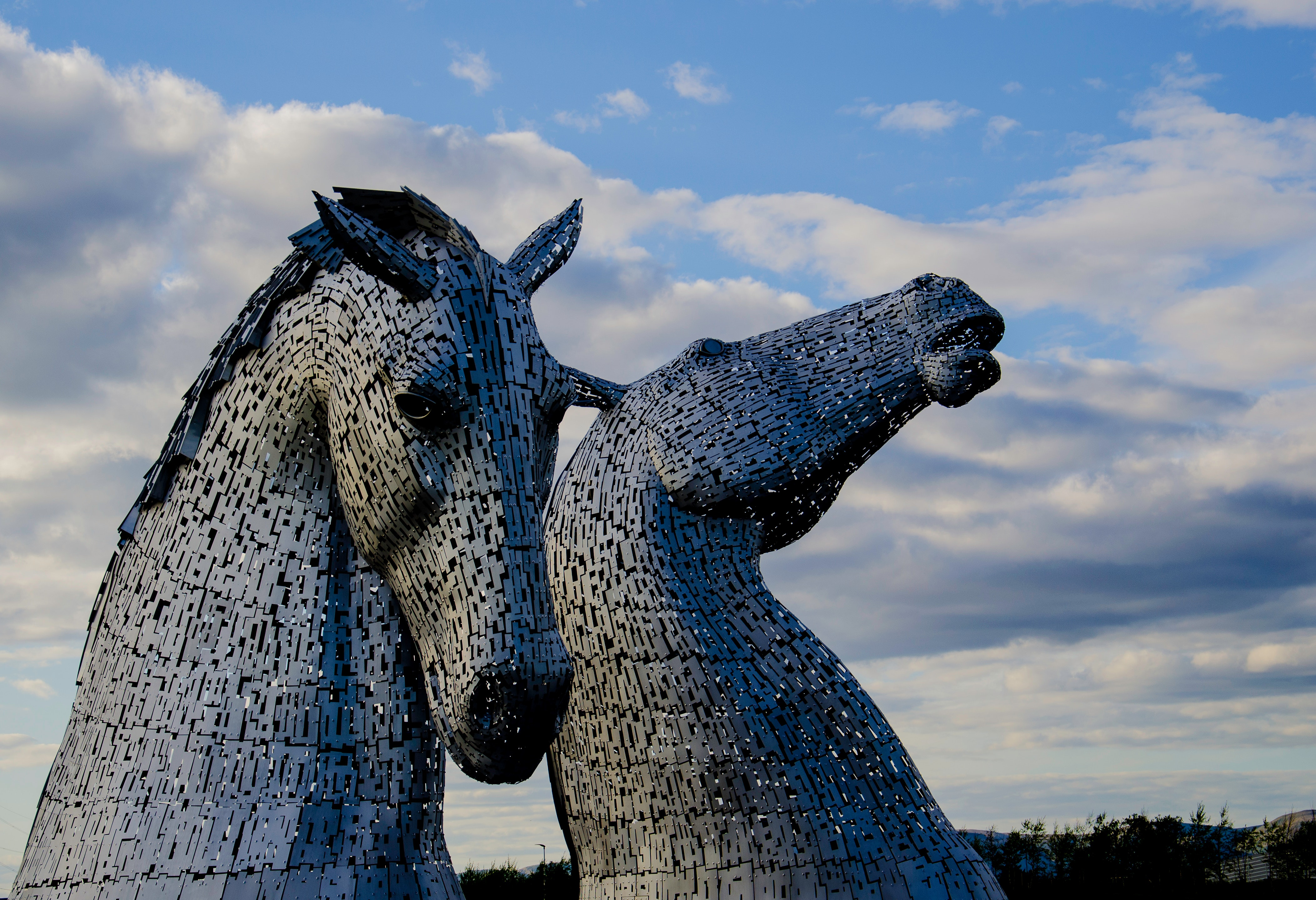 Two gray horse statues photo