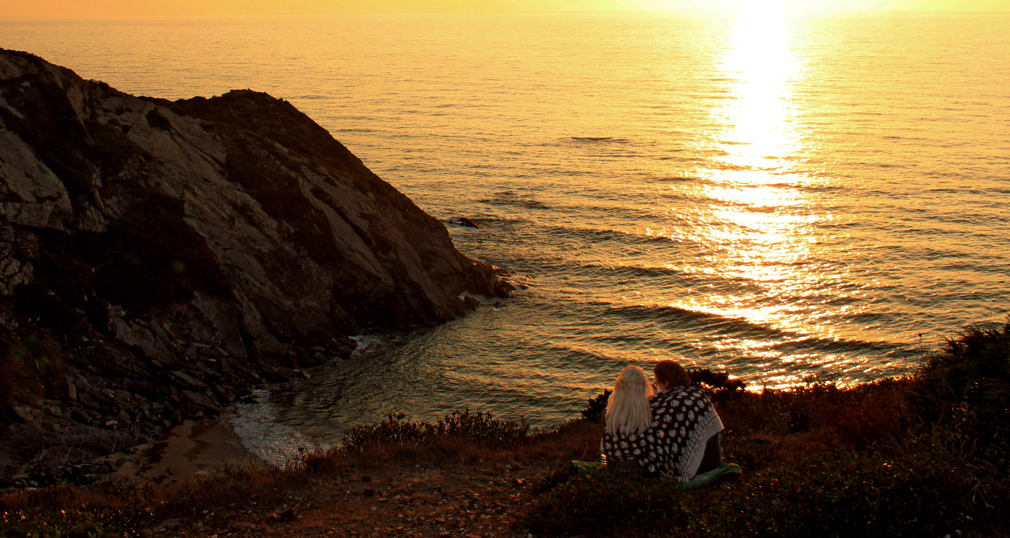 Two lovers watching a fiery sunset photo