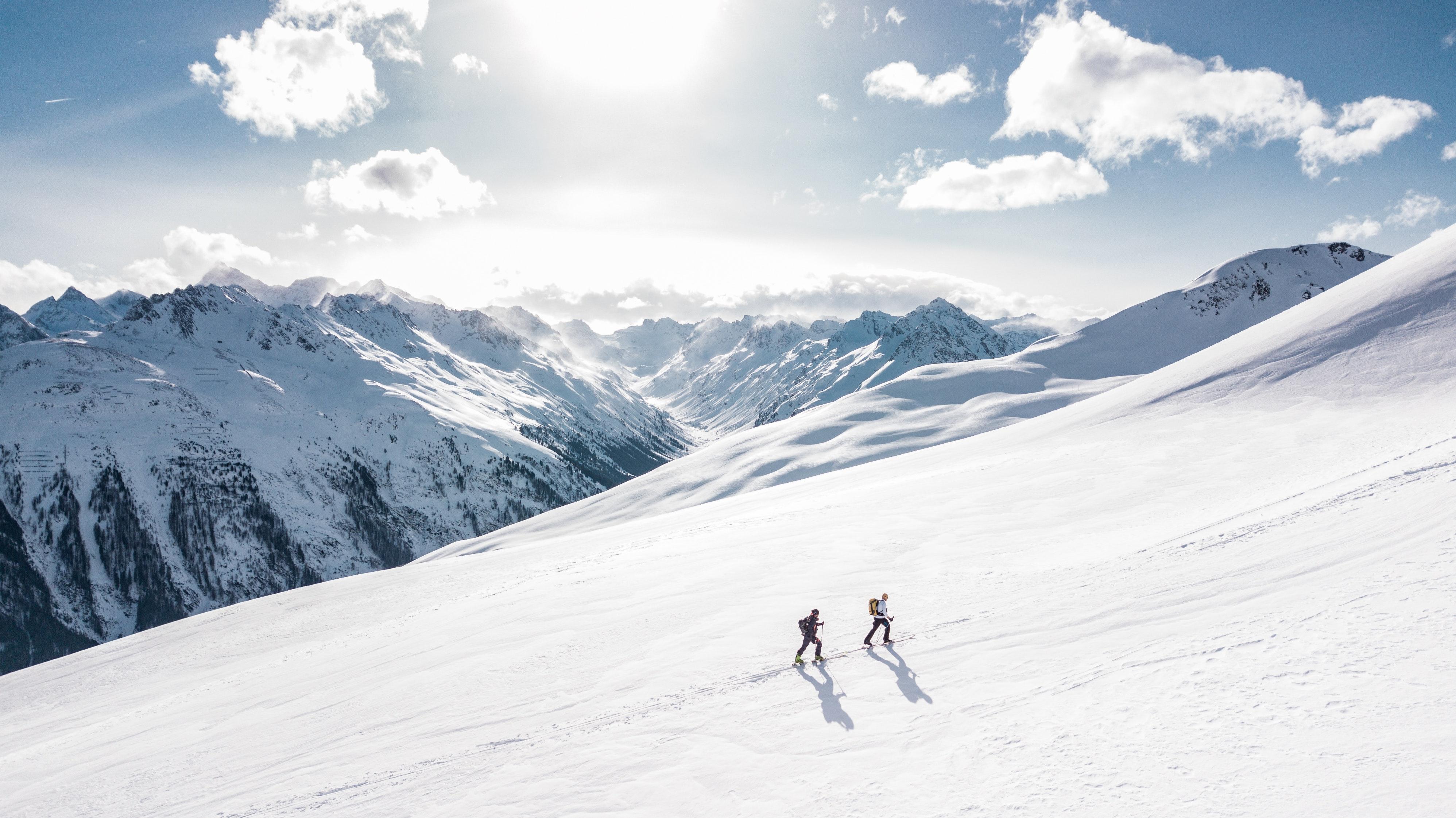 Two man hiking on snow mountain photo