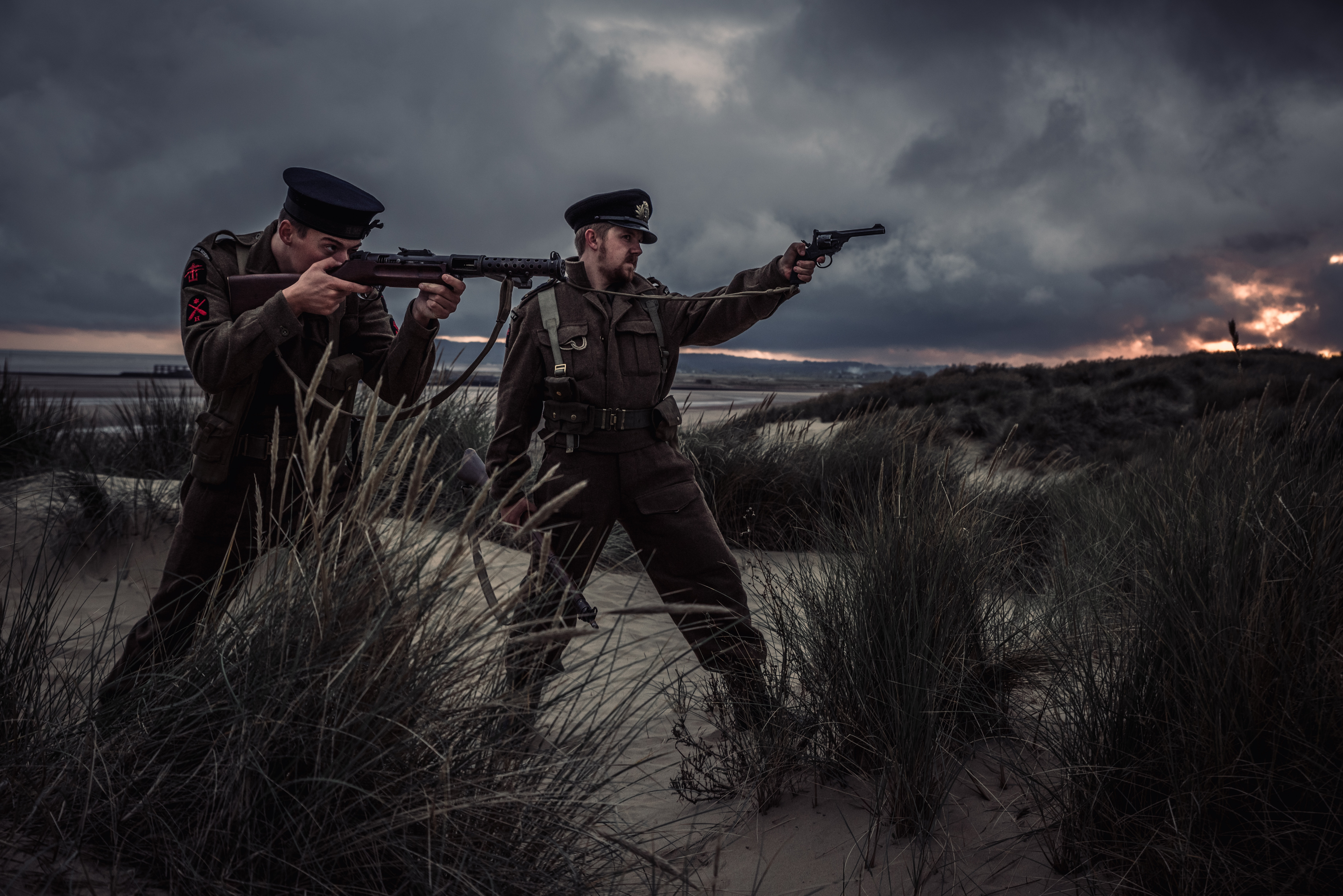 Two man holding rifle and pistol illustration photo