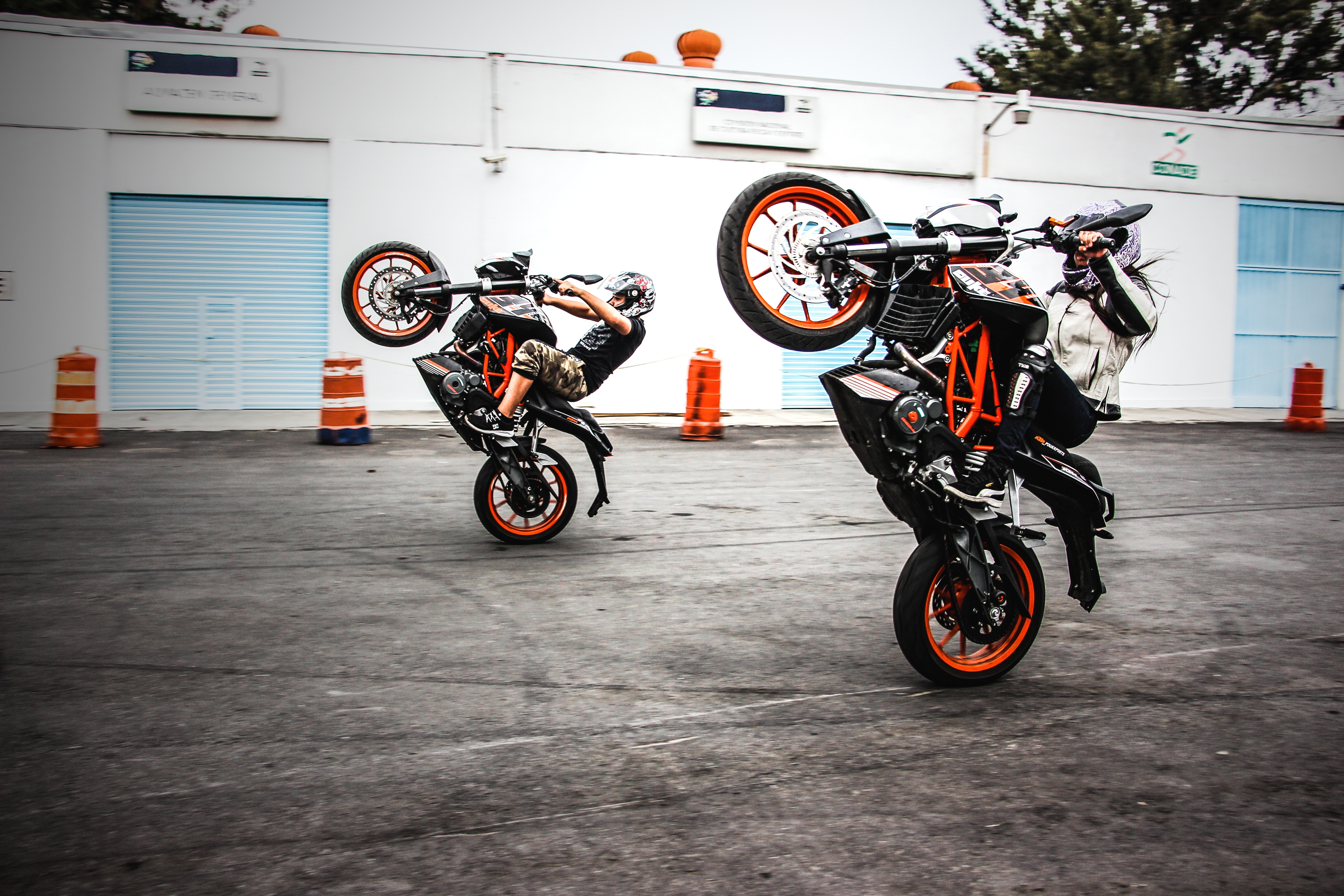 Two Men Riding Orange-and-black Sports Bikes While Doing Exhibition, Action, Outdoors, Transportation system, Stunt, HQ Photo