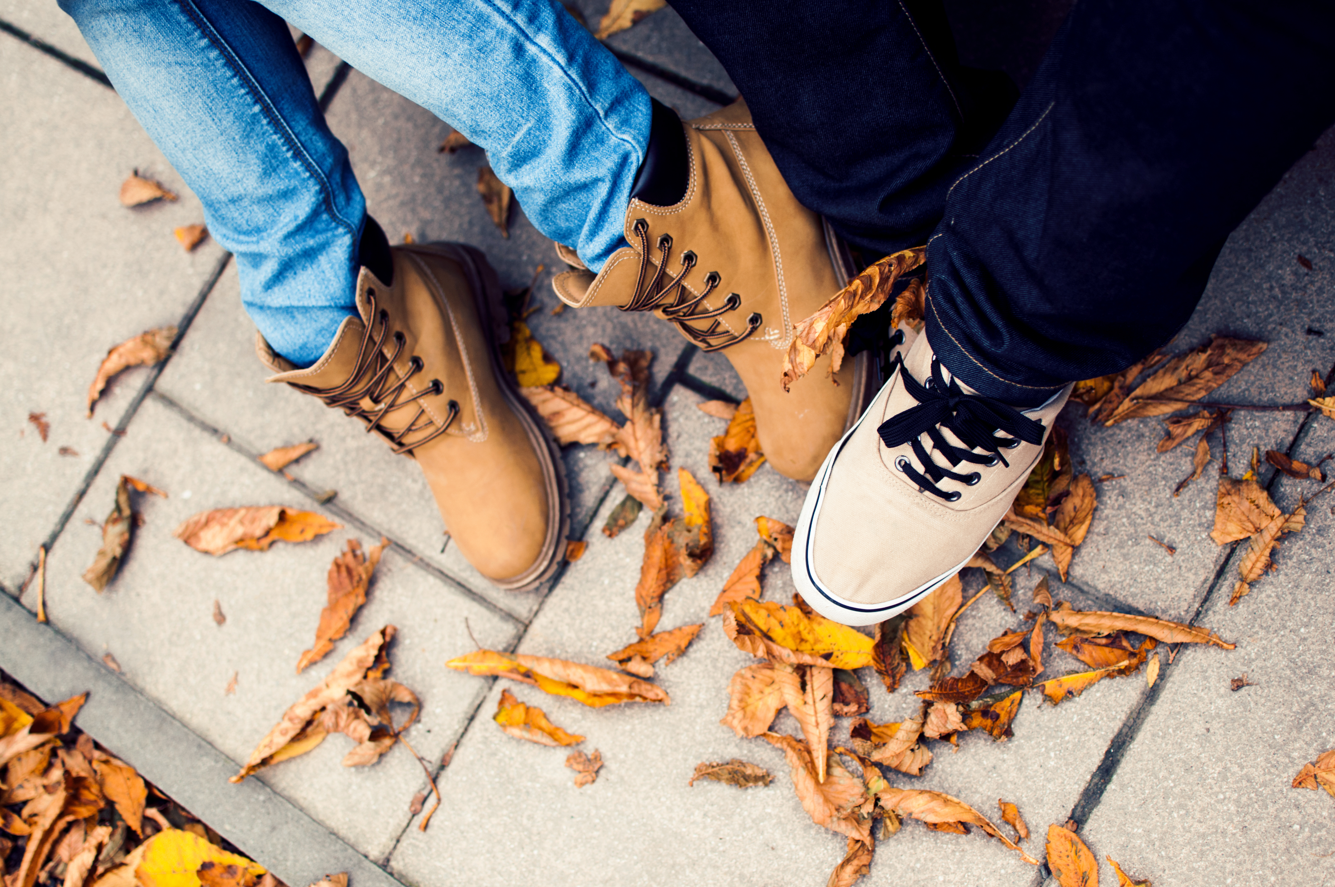 Two pairs of feet in shoes photo