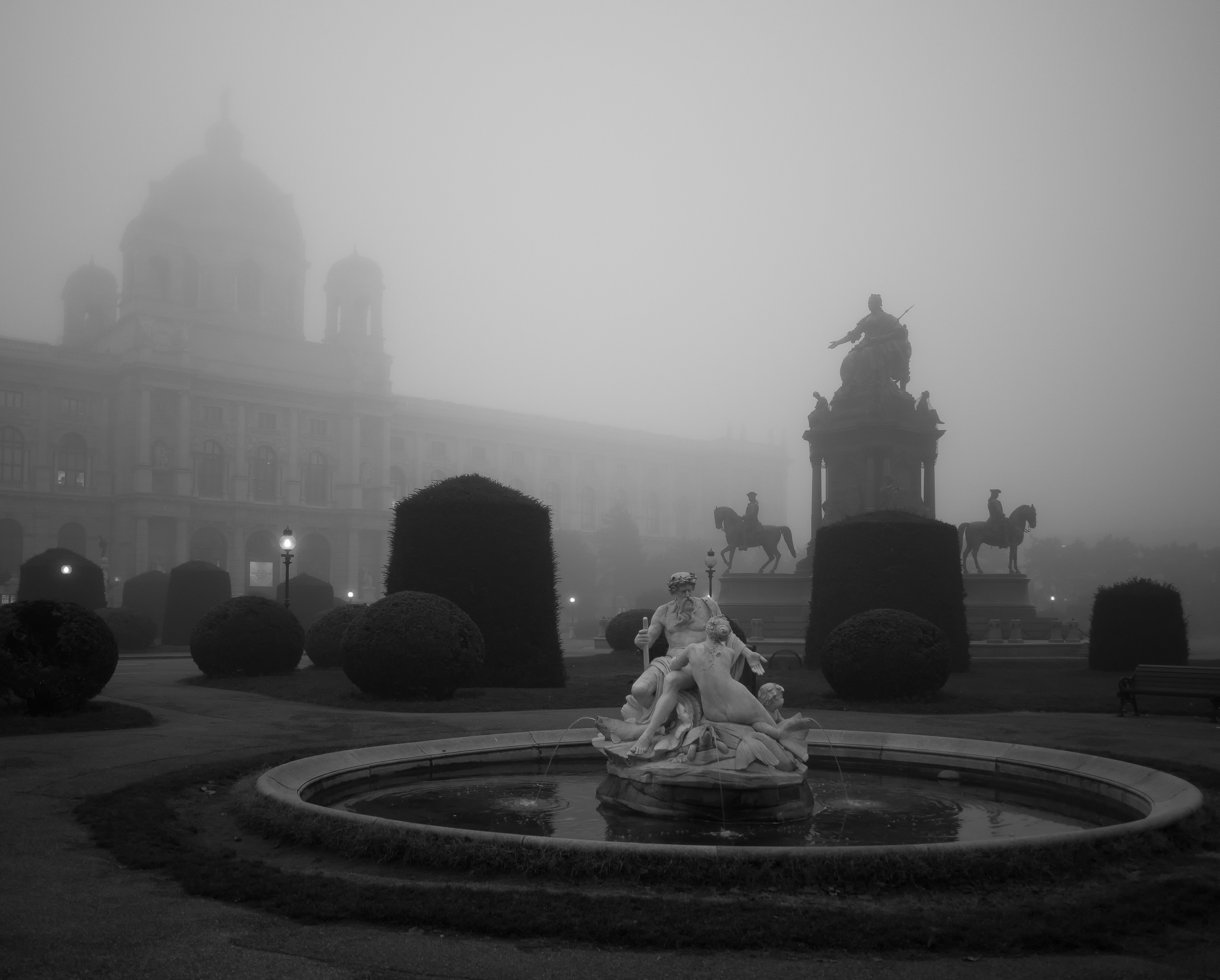 Two people statue over fog photo