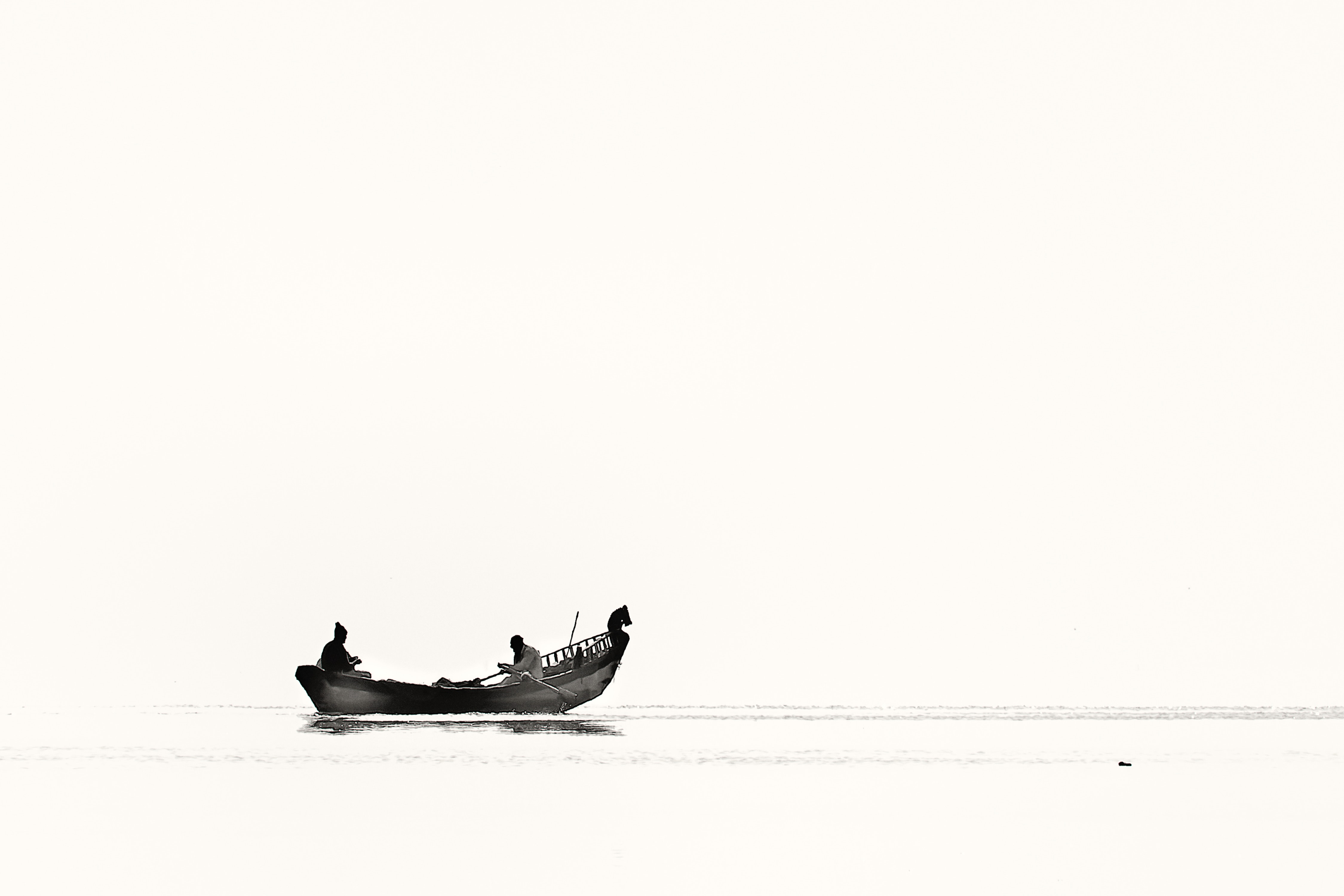 Two person riding boat on body of water photo