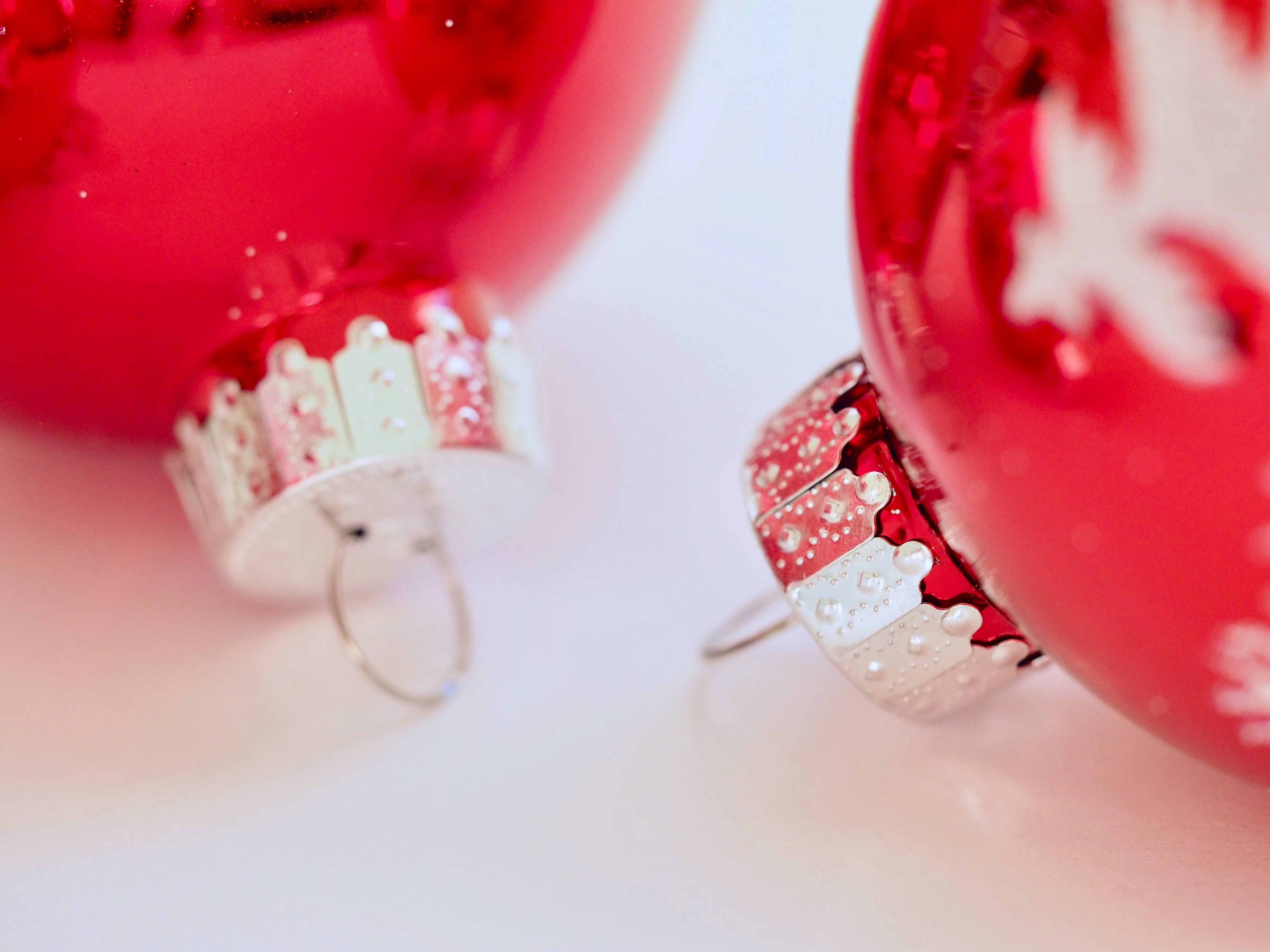 Two red christmas ornaments photo