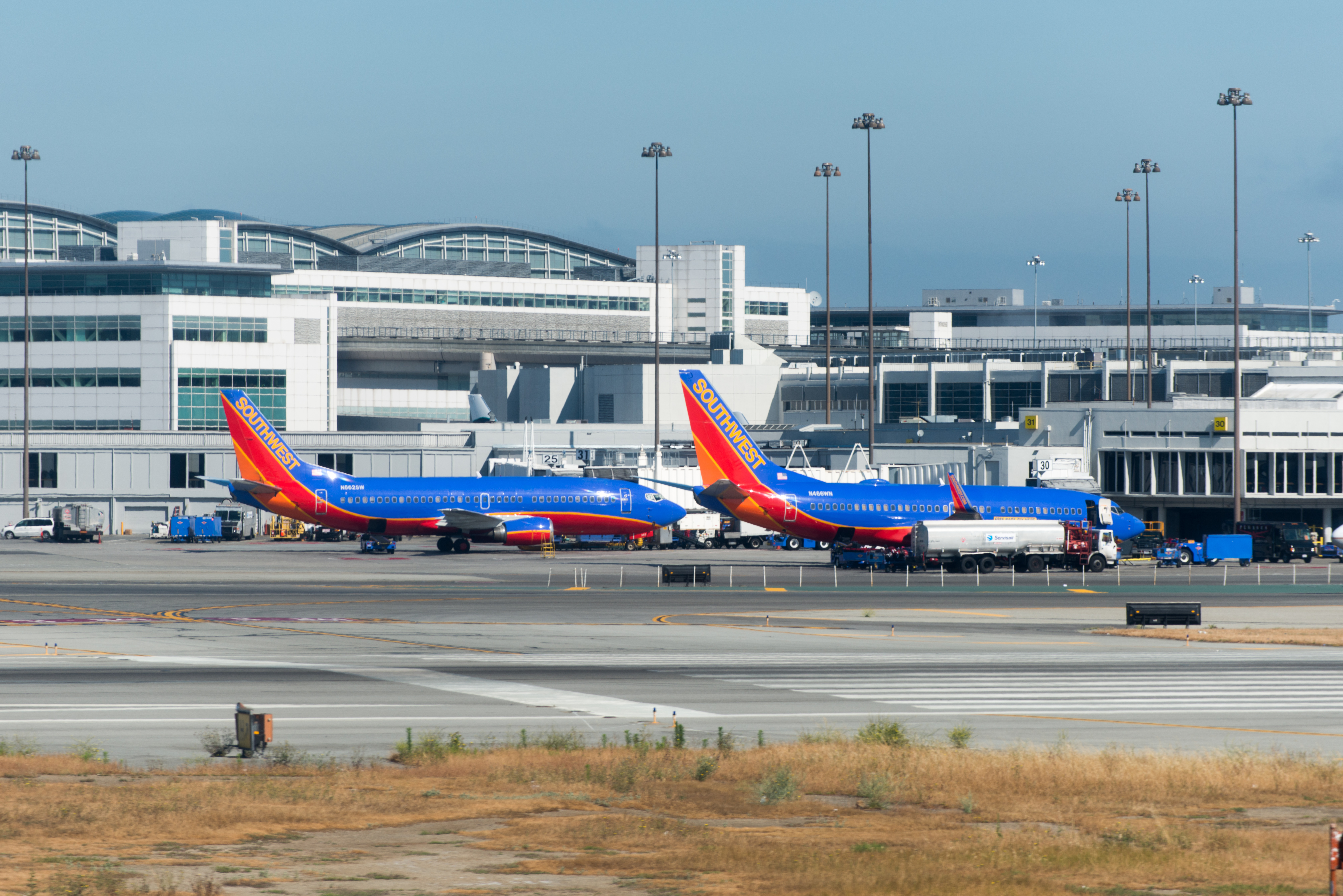 Two southwest airlines planes in front of san francisco international airport (sfo) photo
