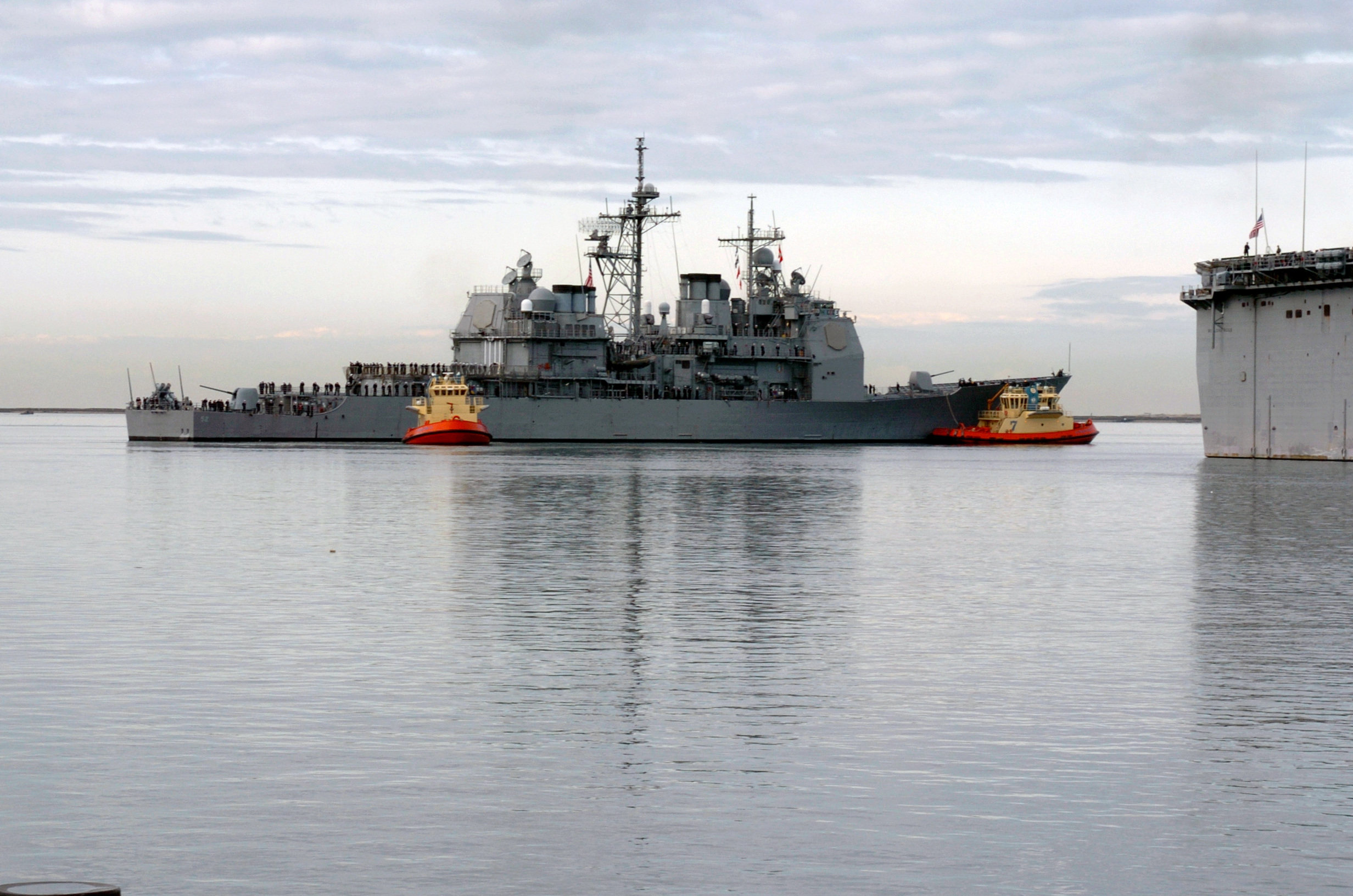 File:US Navy 041206-N-0685S-006 Two tug boats assist the guided ...