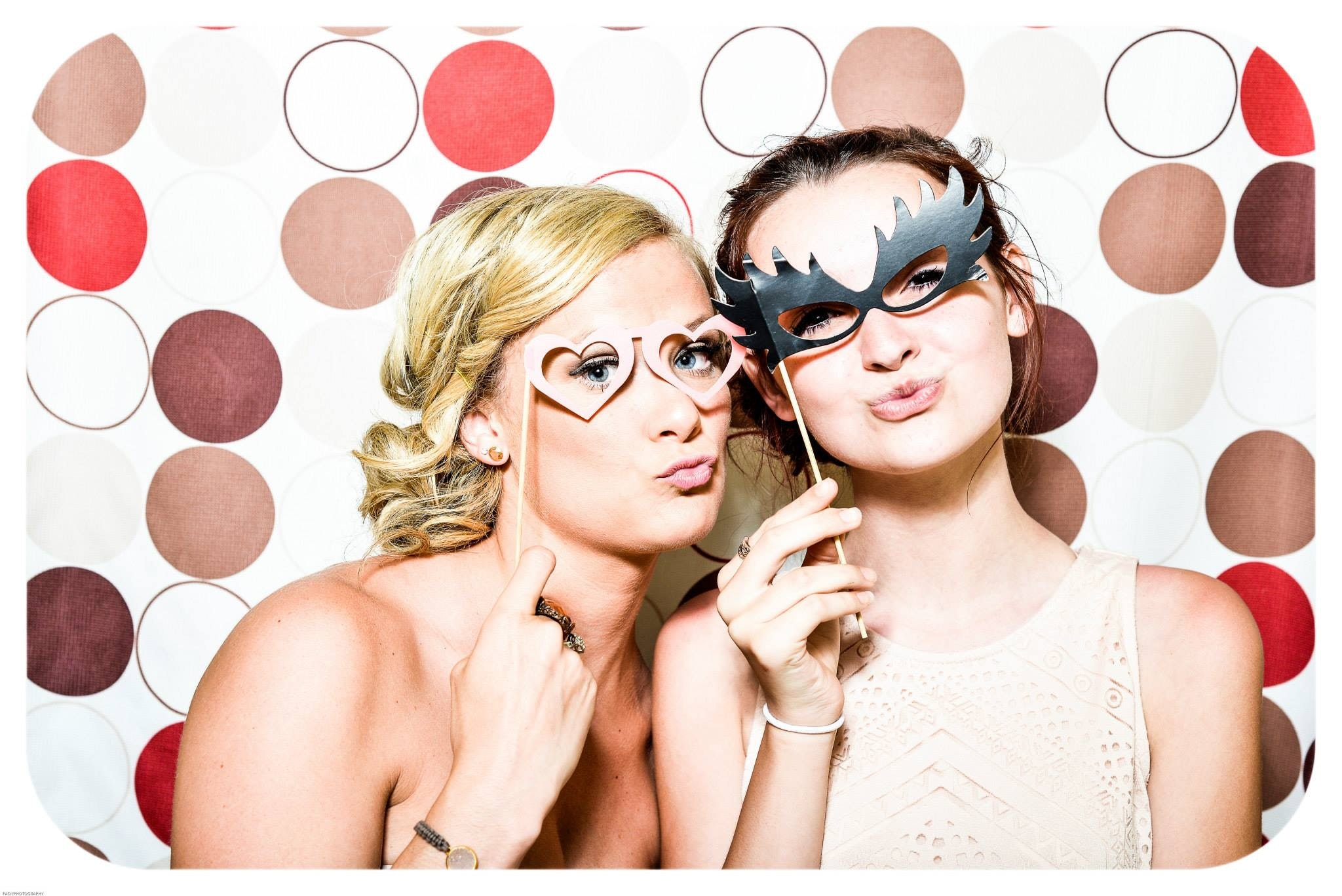 Two Woman Taking Photo in Photobooth Holding Black and Pink Masquerade Mask, Photobooth, People, Party, Proof, HQ Photo