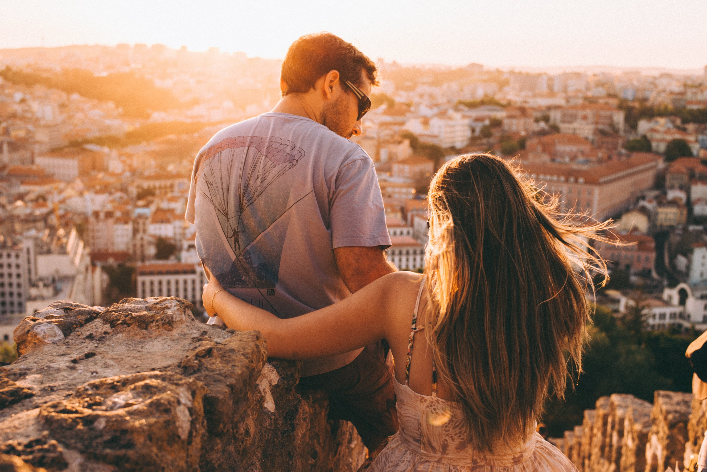 Couple sitting on rock HD wallpaper   Wallpaper Flare