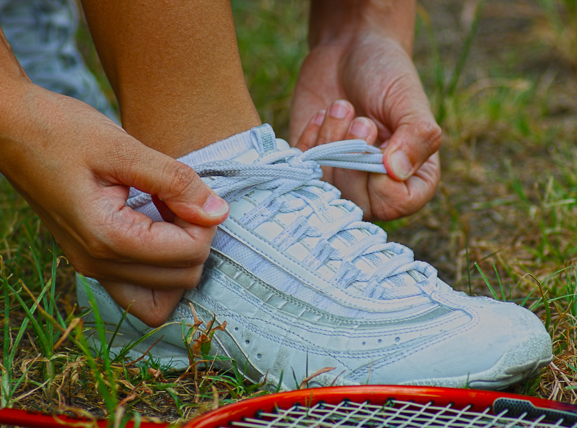 Tying shoes ready for a game of badminton photo
