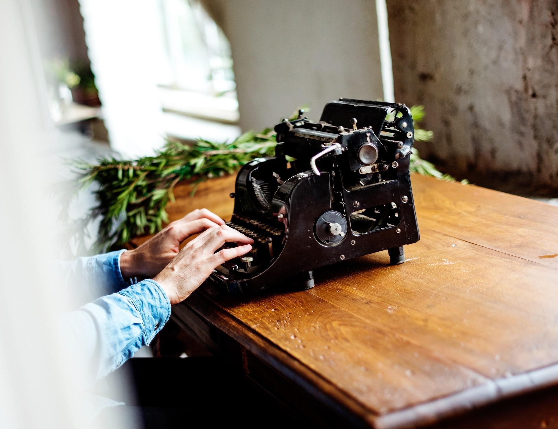 Typing on the typewriter photo