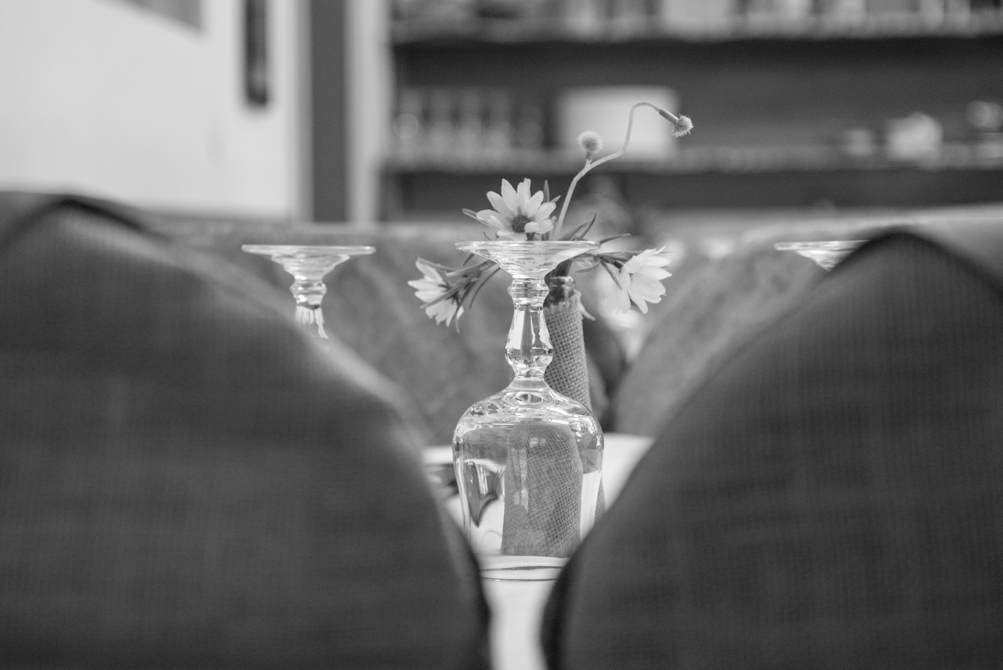 Upside Down Wine Glass Behind the Flower Grayscale Photo, Black and white, Blur, Chairs, Diner, HQ Photo