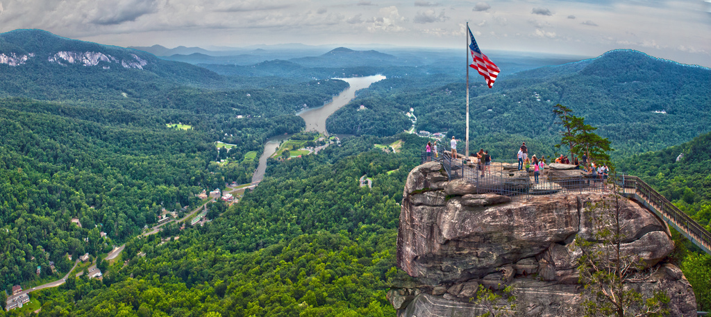 Usa flag on top of cliff photo