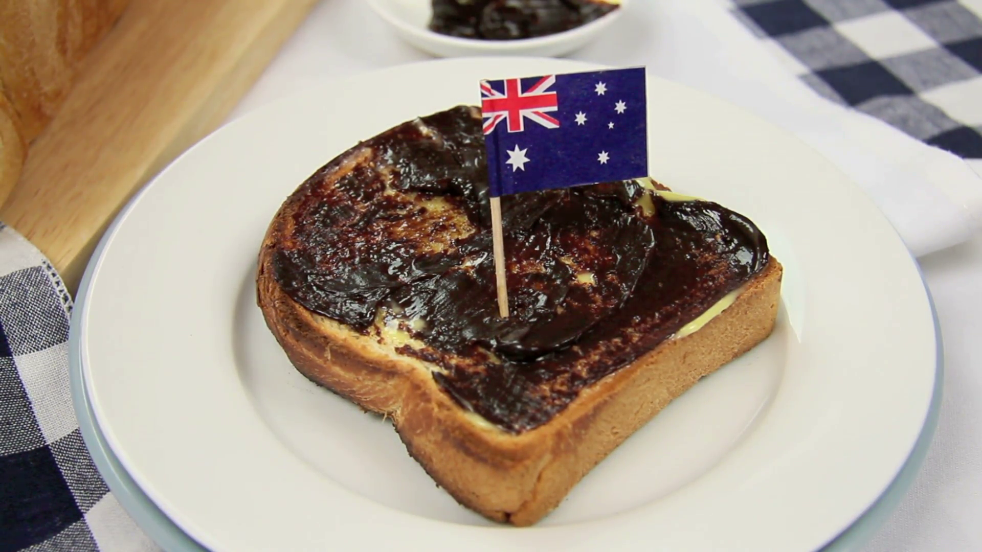 Australian flag being put in a piece of toast with vegemite. Stock ...
