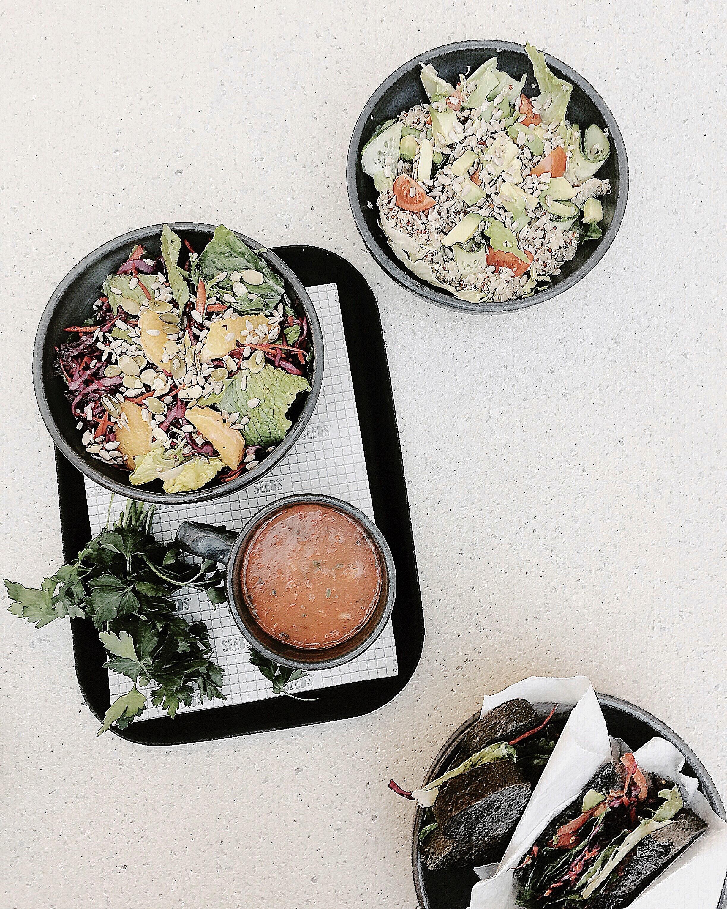 Vegetable salad on black tray photo