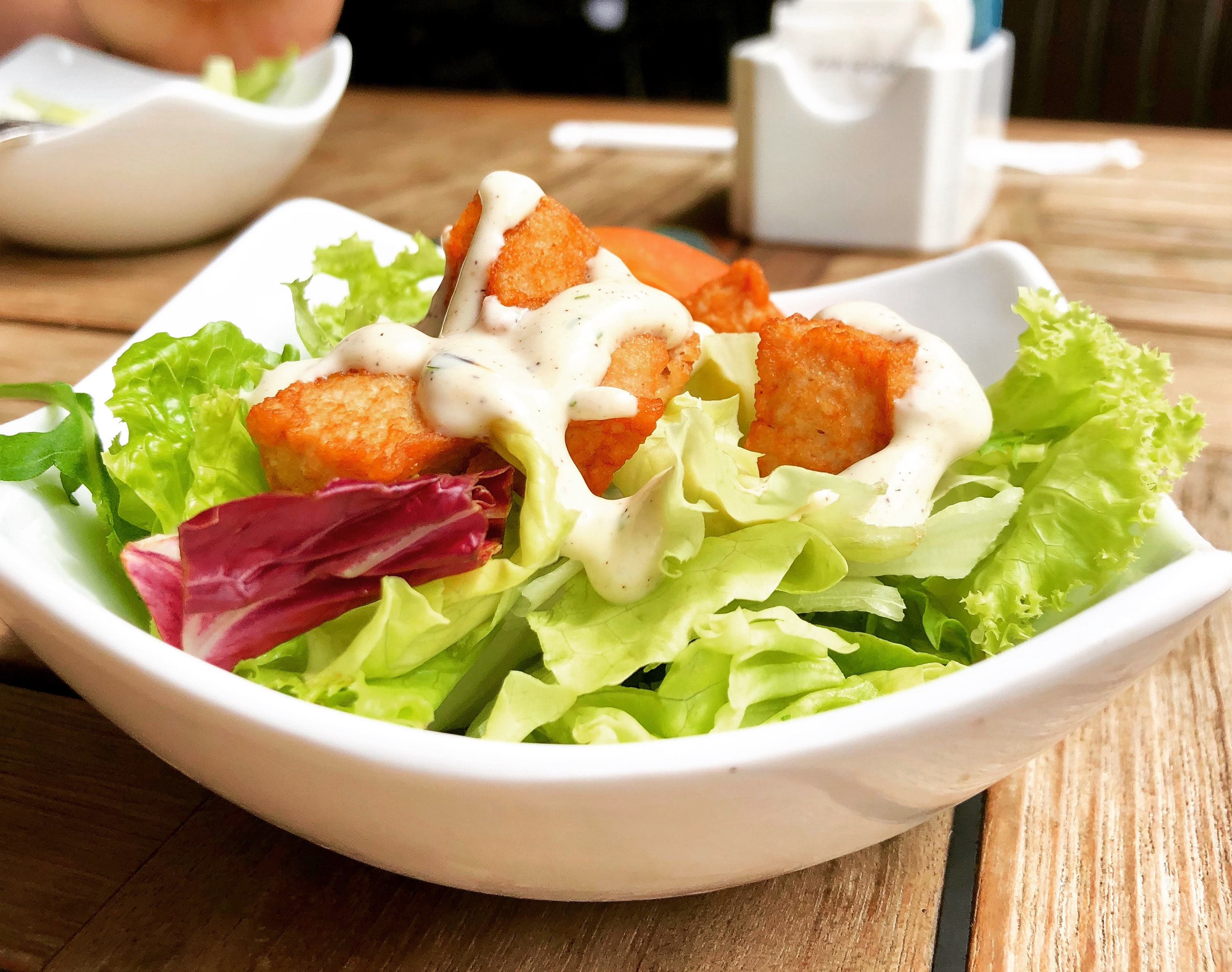 Vegetable salad on top of white ceramic plate photo