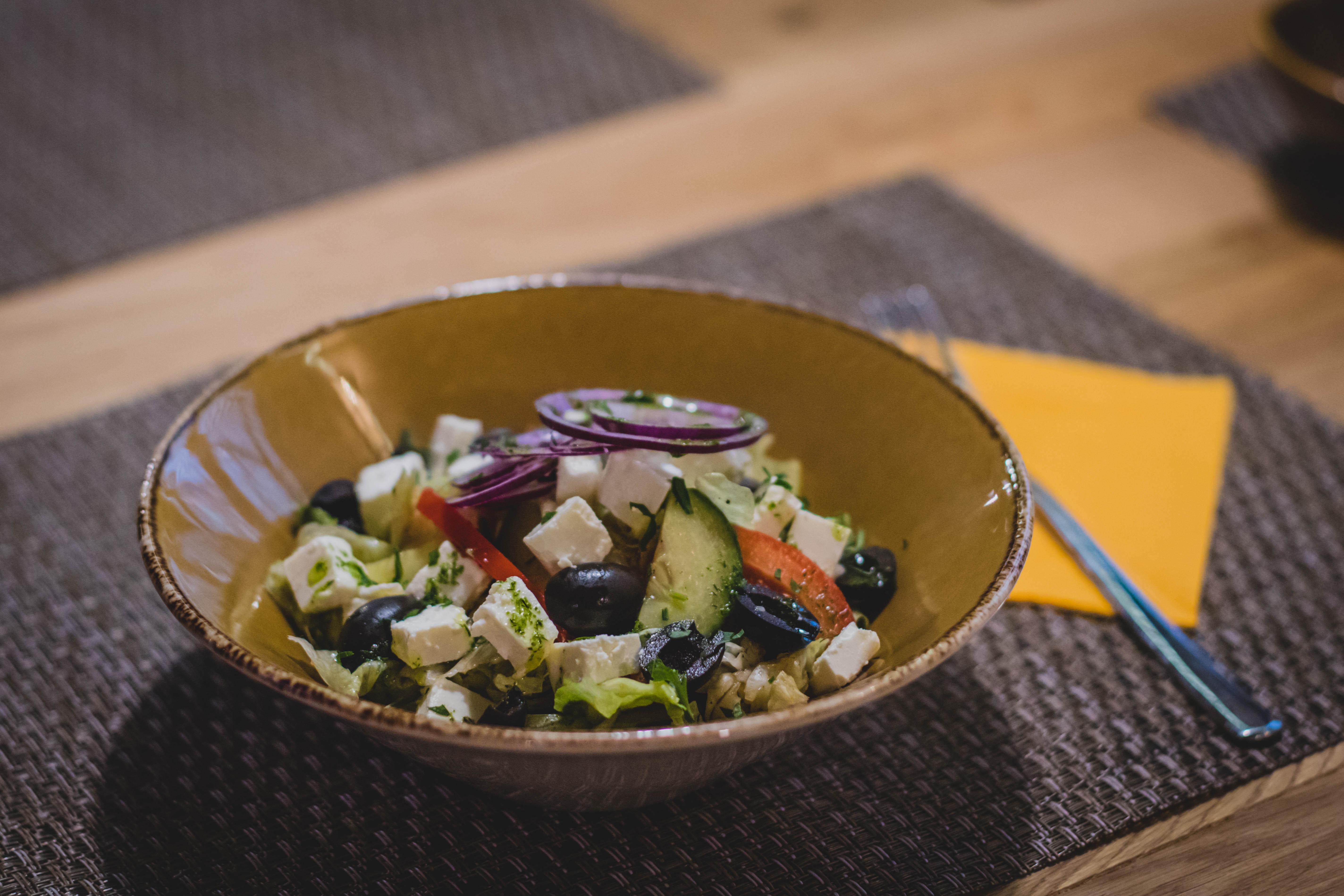 Vegetable slices on brown ceramic bowl photo