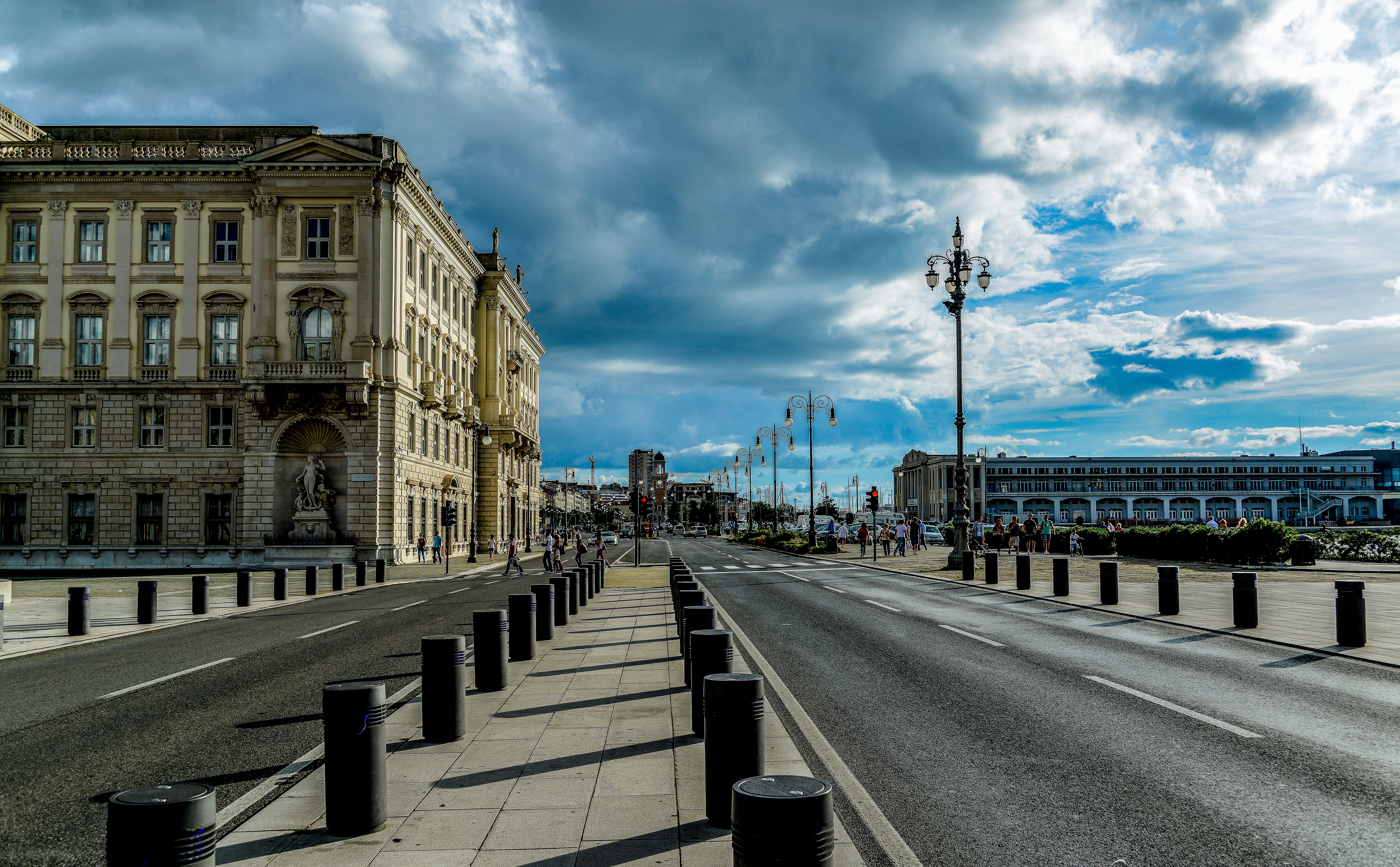 View of city street against cloudy sky photo