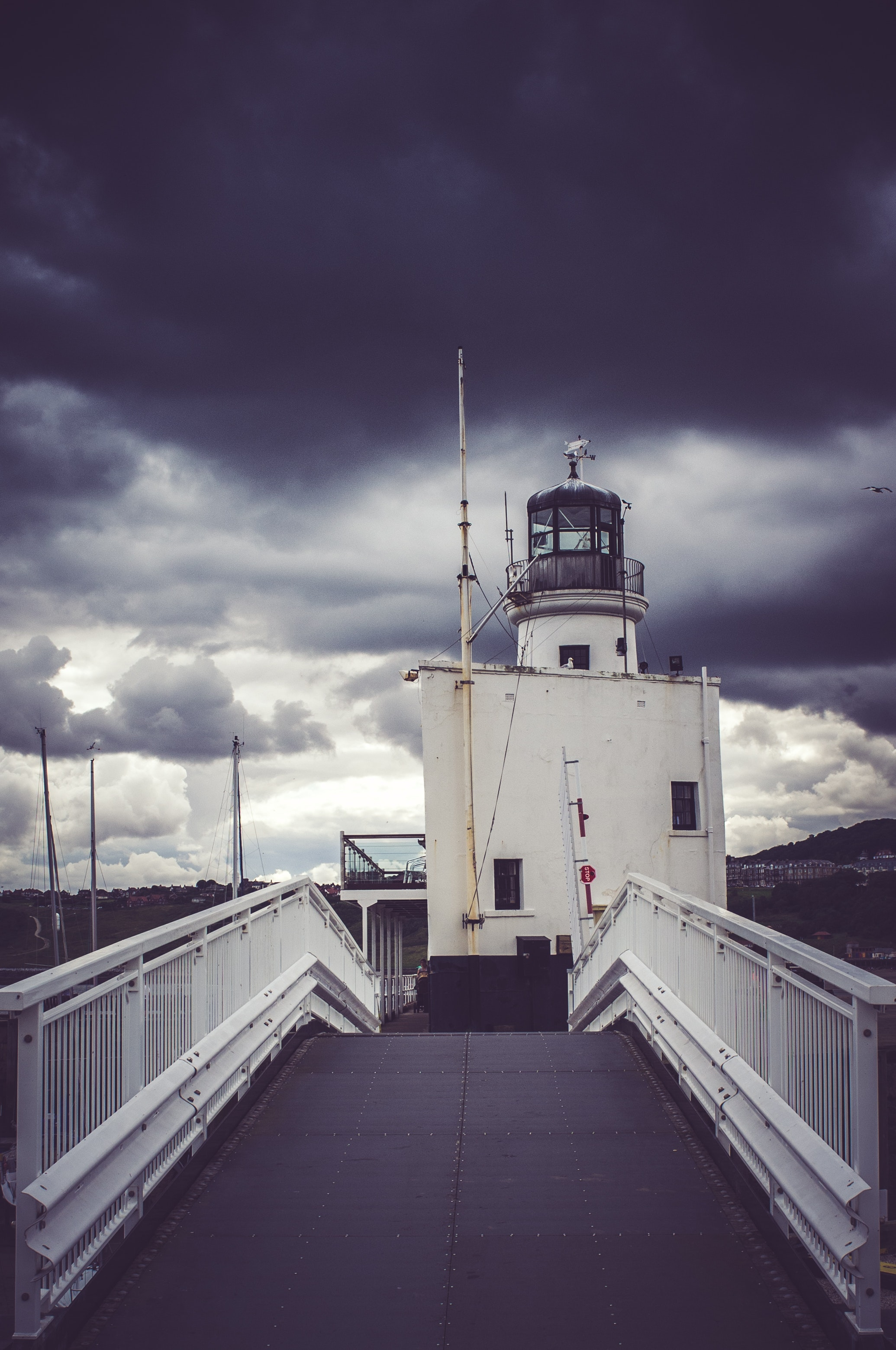 View of cloudy skies on lighthouse photo