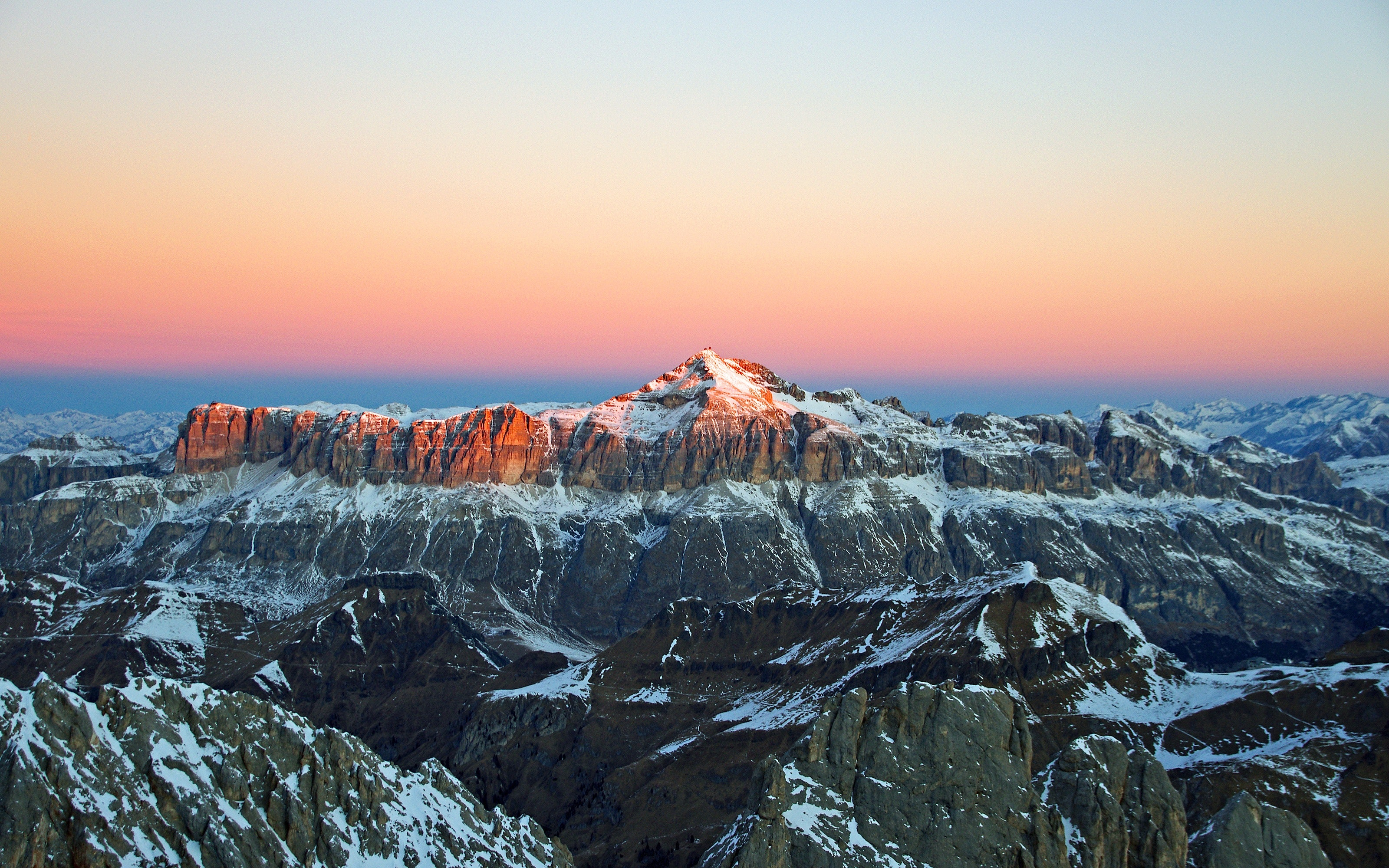 View of snow covered mountain during sunset photo
