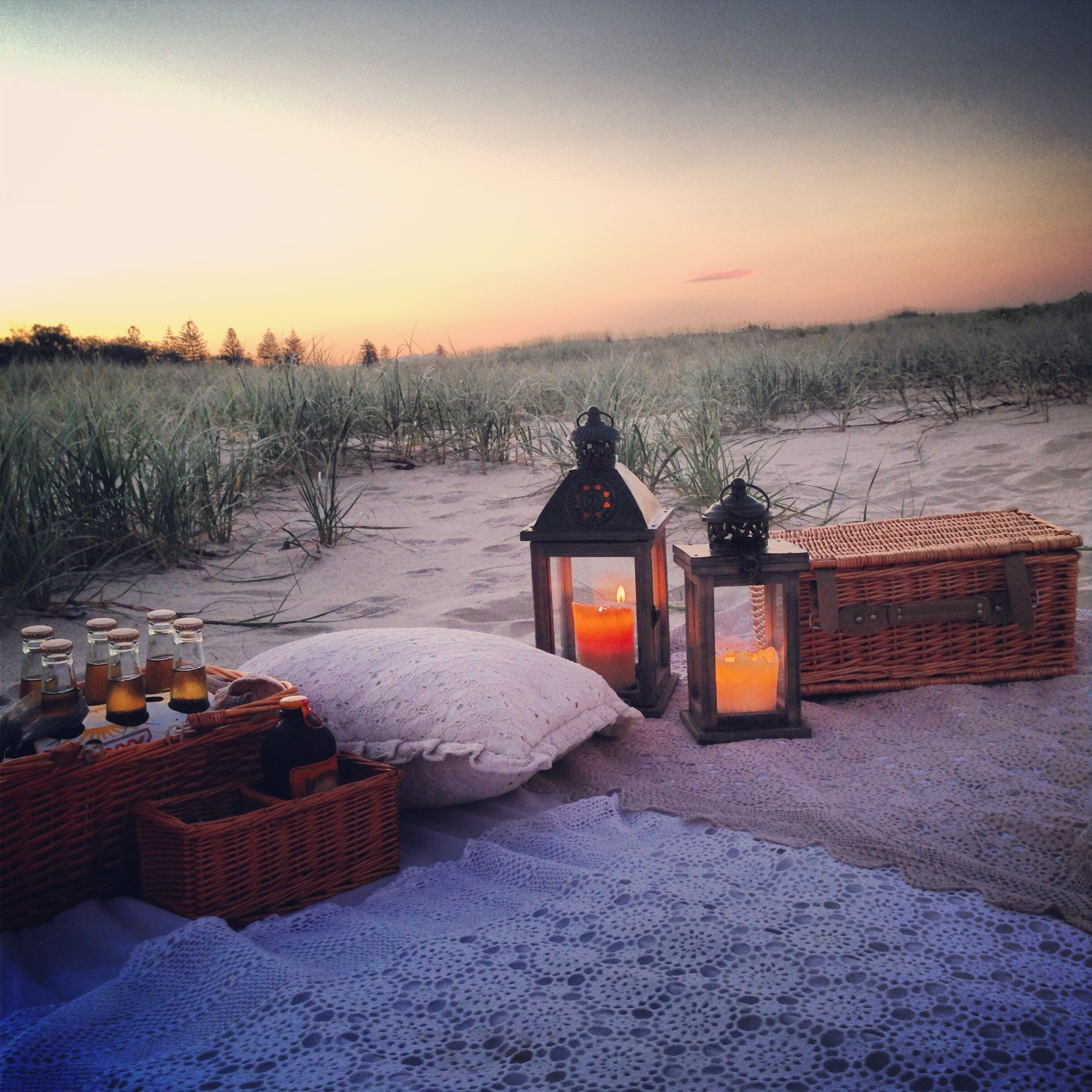 Beach picnic at sunset ~ with lanterns, candles, vintage crochet ...