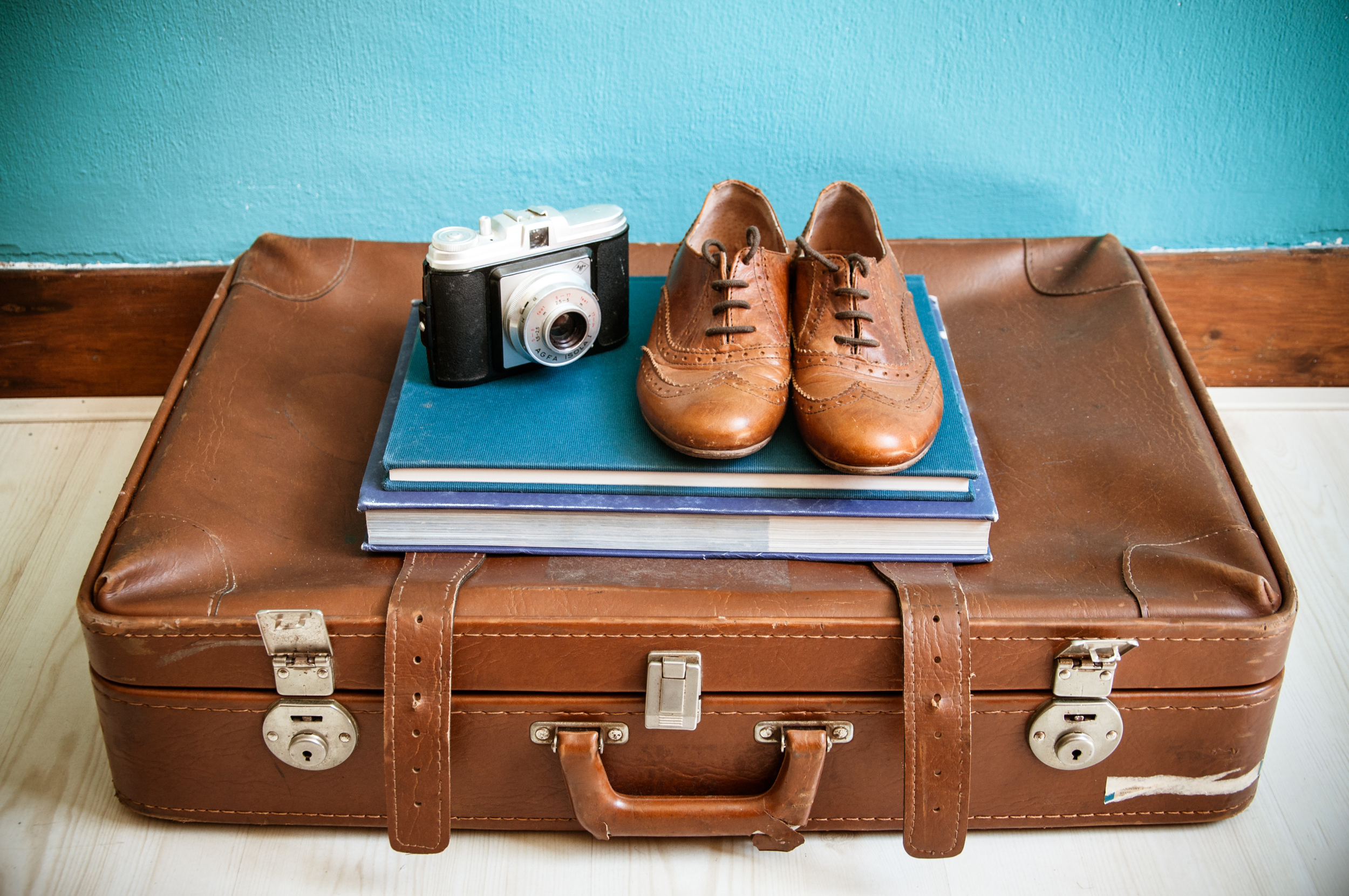 Vintage still life with suitcase photo