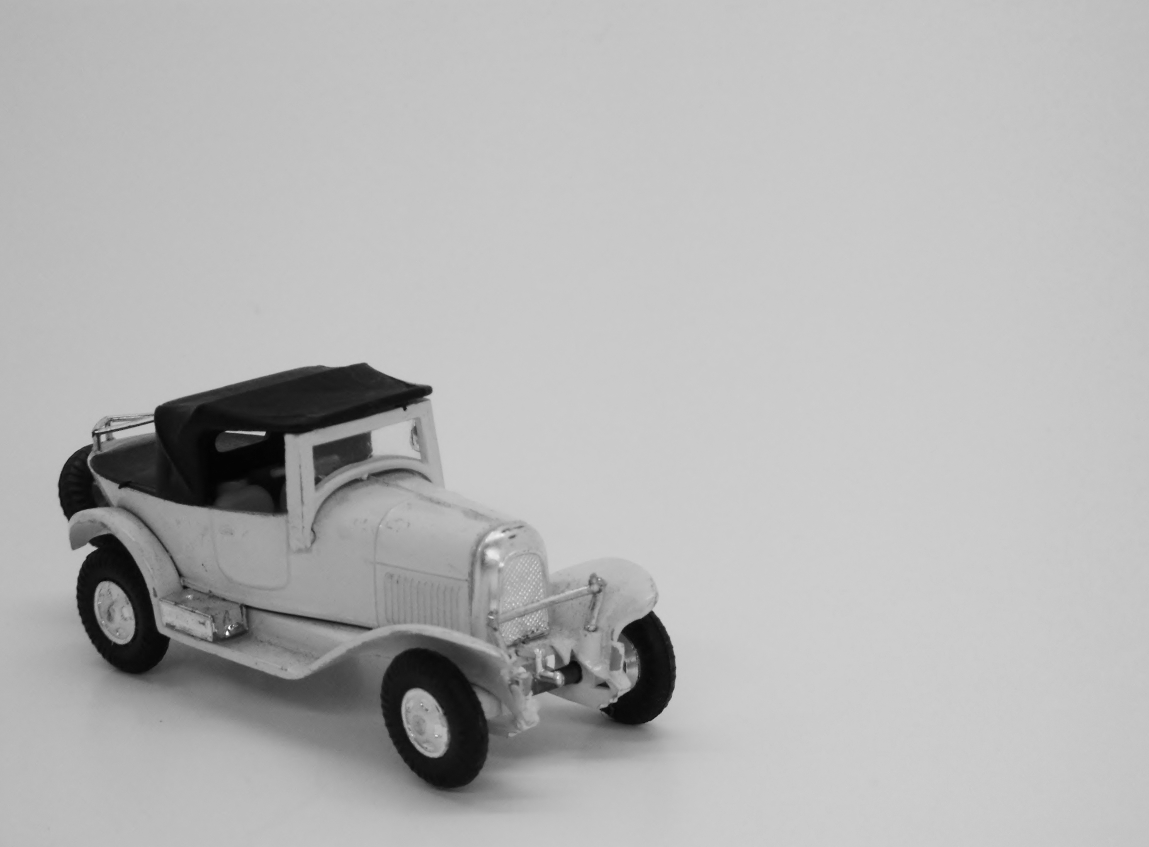 Vintage toy automobile - black and white photo