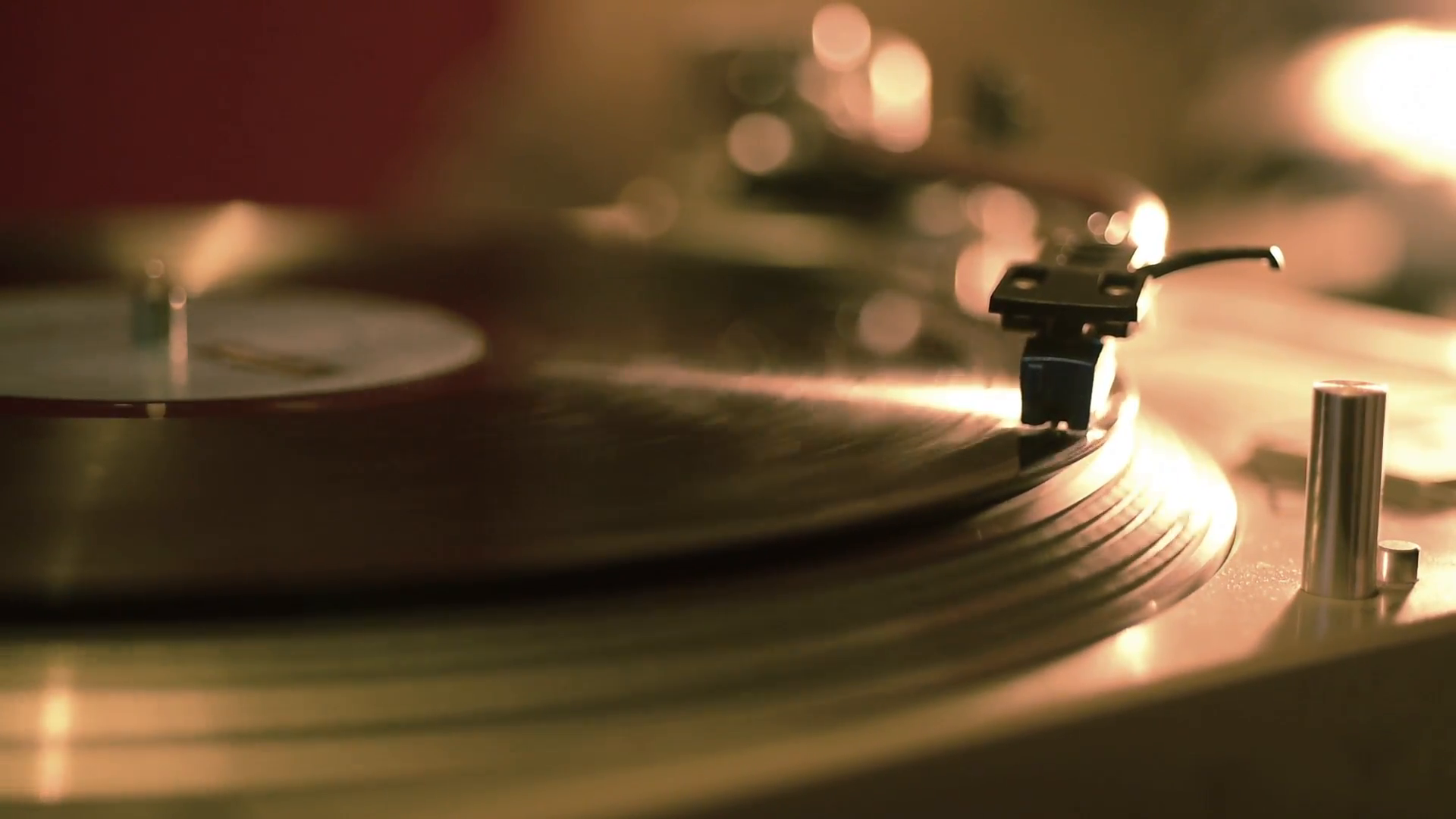 Close up dolly shot of a vintage record player playing a vinyl ...