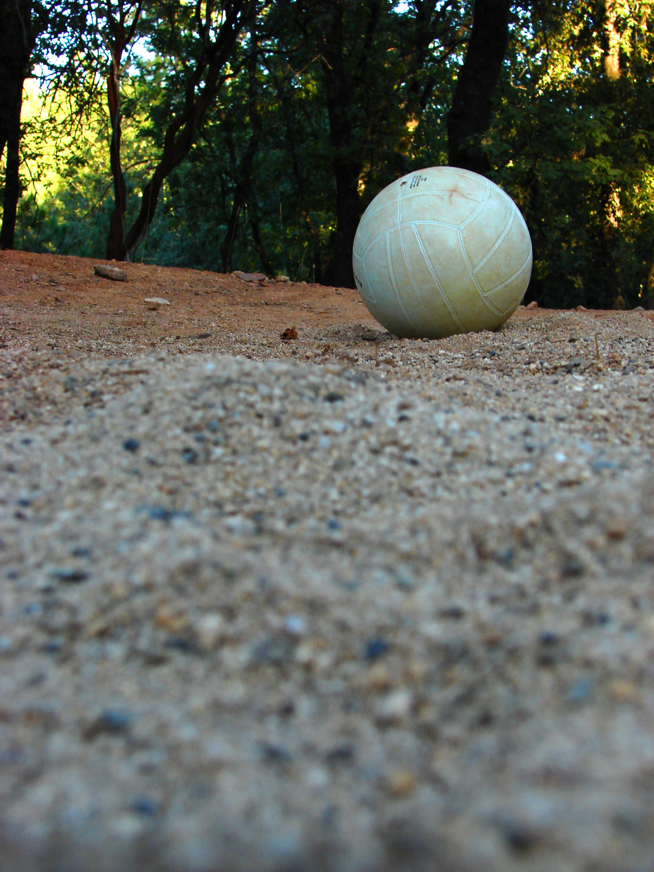 Volleyball on red ground photo