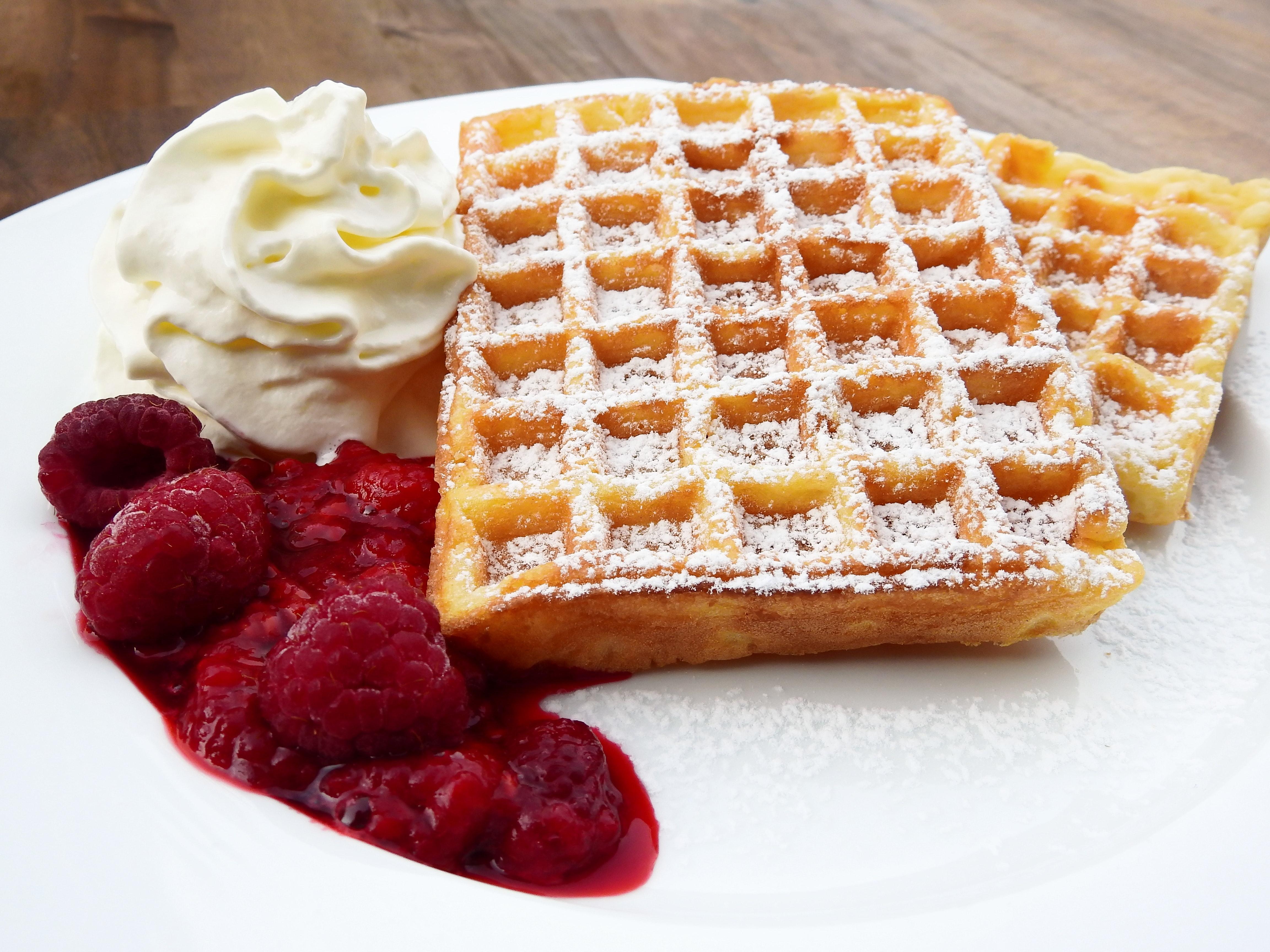 Waffle beside cherry and ice cream photo