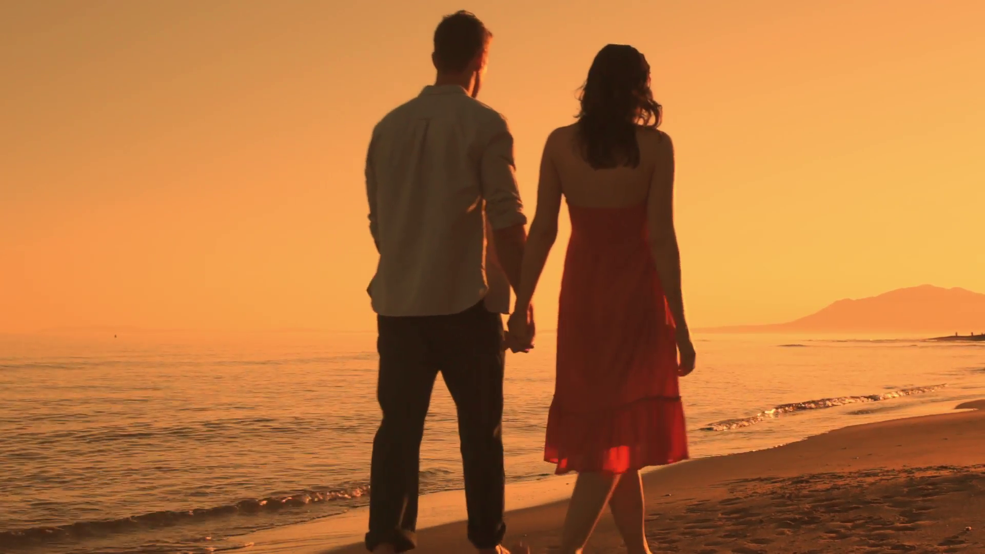 Young couple walking on beach in sunset. Stock Video Footage ...