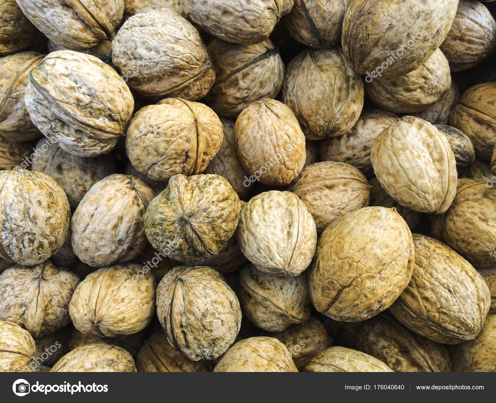 Walnuts background. Walnuts texture. Walnuts background. Organic ...