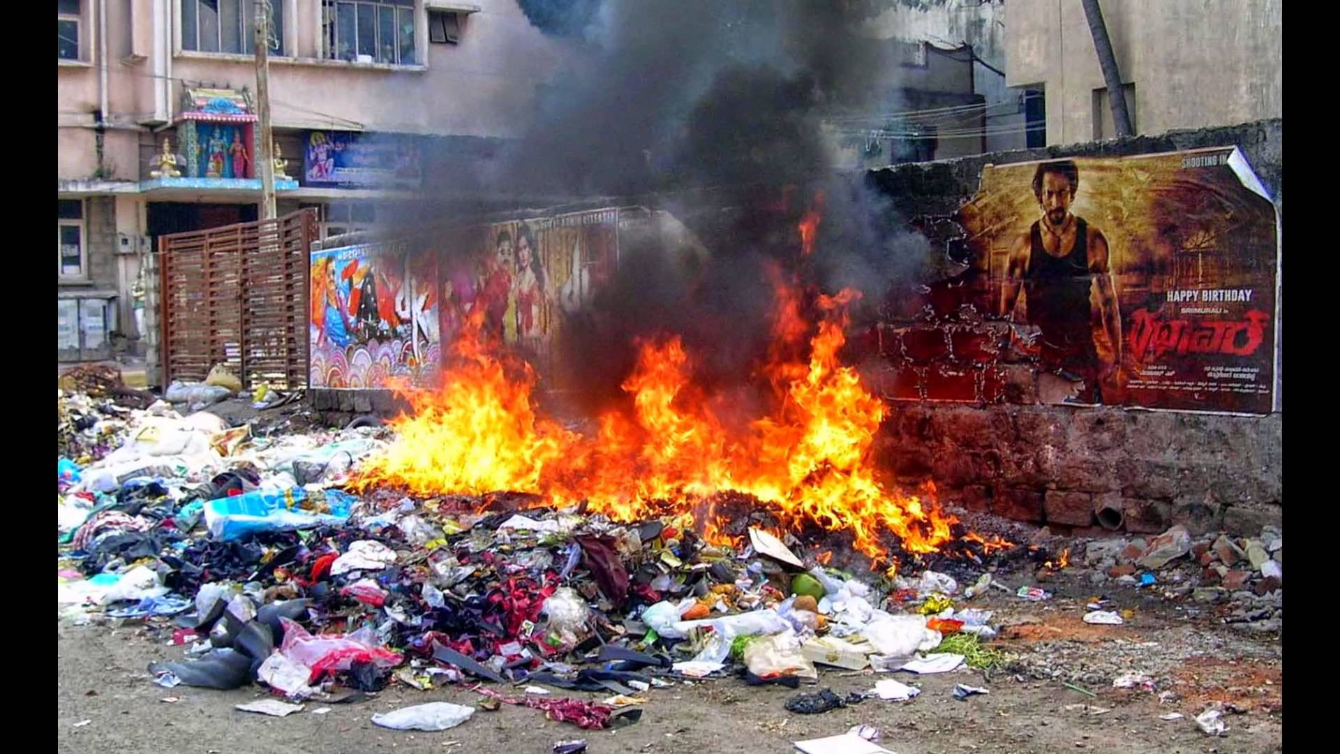 Garbage being disposed by burning at a garbage dump - YouTube